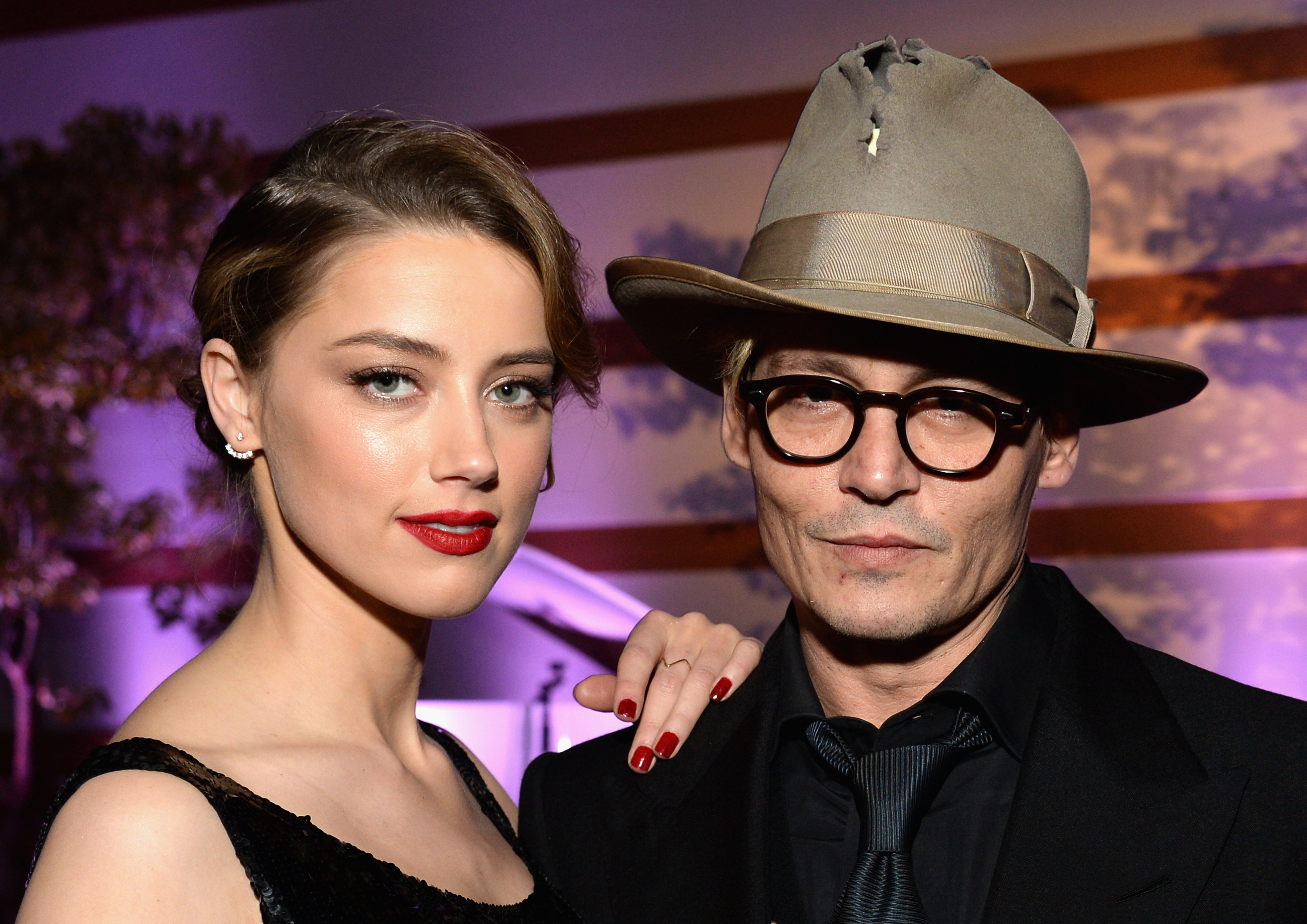 Actors Amber Heard (L) and Johnny Depp attend The Art of Elysium's 7th Annual HEAVEN Gala presented by Mercedes-Benz at Skirball Cultural Center on January 11, 2014 in Los Angeles, California.