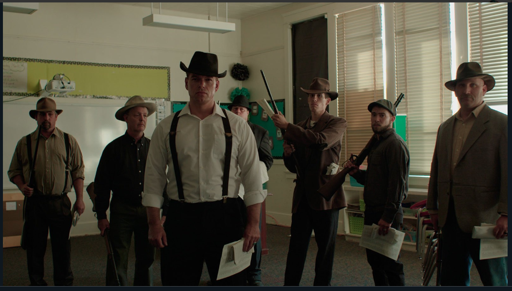 The townspeople can be seen playing the characters of the deputies in a still from Bisbee'17.