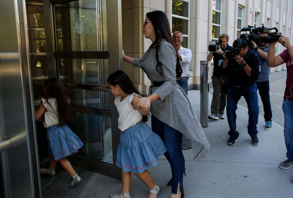 The wife of Joaquin (El Chapo) Guzmán, Emma Coronel Aispuro, arrives with their twin 7-year-old daughters at the federal courthouse in Brooklyn. (Photo credit: Getty Images)