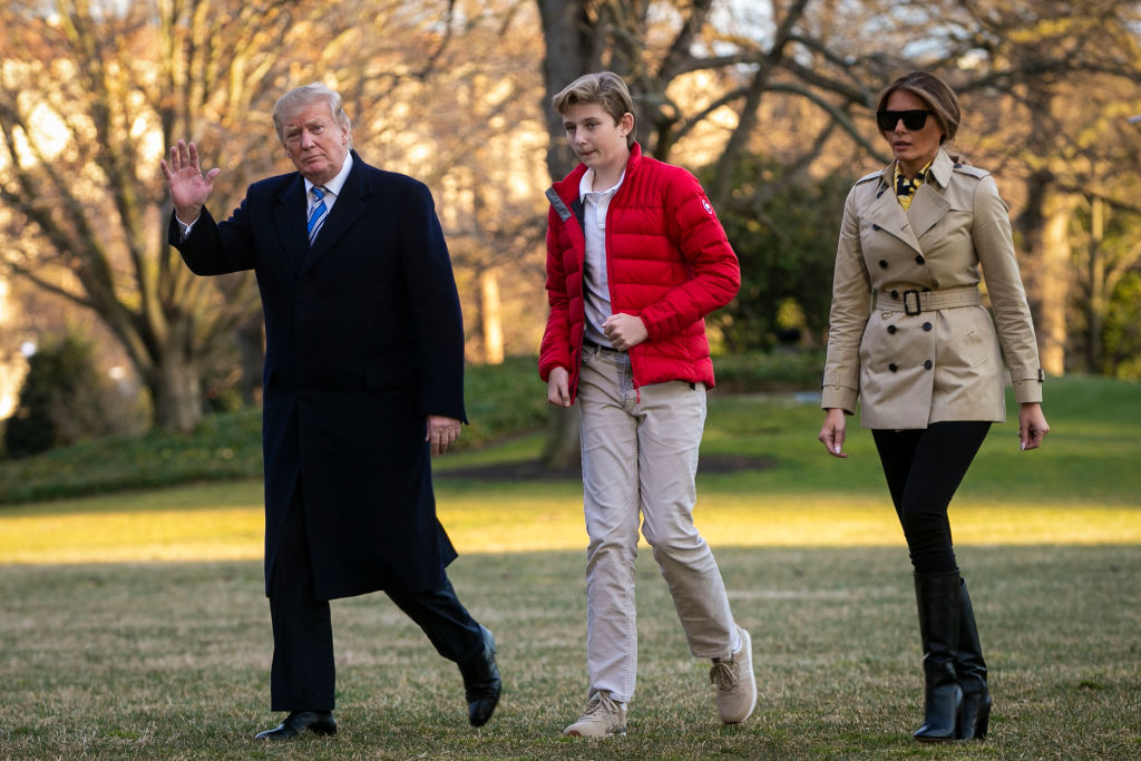 U.S. President Donald Trump, First Lady Melania Trump, and their son Barron Trump, arrive on the South Lawn of the White House, on March 10, 2019, in Washington, DC. (Photo by Al Drago/Getty Images)