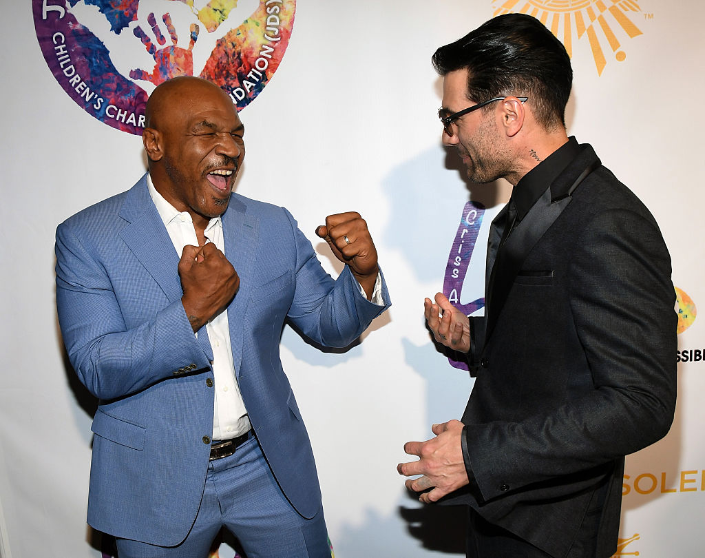 Former boxer Mike Tyson (L) and illusionist Criss Angel joke around as they attend Criss Angel's HELP charity event at the Luxor Hotel and Casino benefiting pediatric cancer research and treatment on September 12, 2016 in Las Vegas, Nevada. (Photo by Ethan Miller/Getty Images)