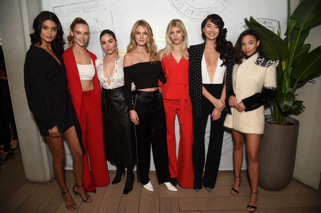 Stars of E!'s Model Squad Daniella Brag, Hannah Ferguson, Olivia Culpo, Caroline Lowe, Devon Windsor, Ping Hue and Ashley Moore pose in the Etihad Airways VIP Lounge at NYFW: The Shows on February 8, 2018 in New York City. (Photo by Bryan Bedder/Getty Images for IMG)