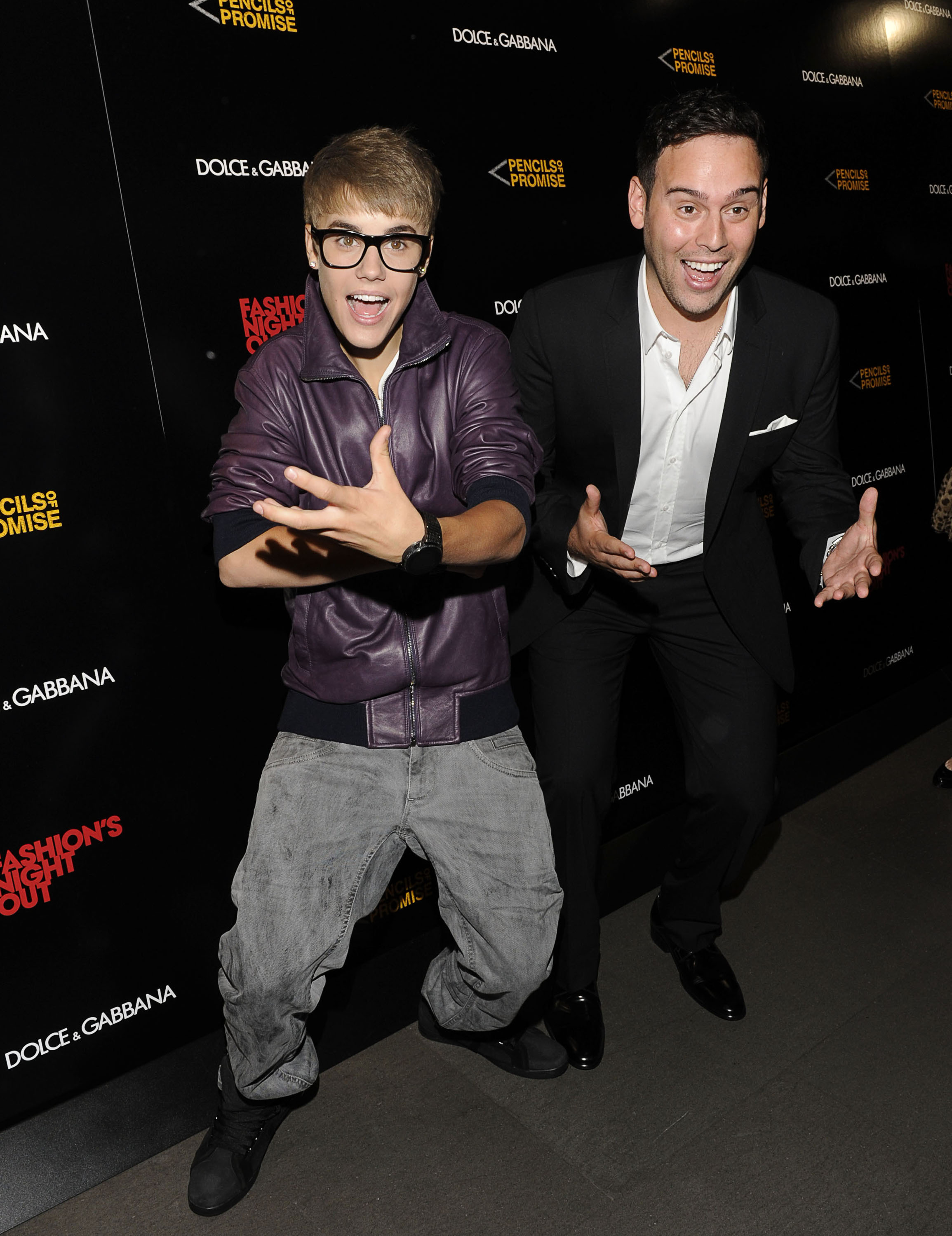 Justin Bieber and Scooter Braun attend the Dolce & Gabbana Boutique on September 8, 2011 in New York City.