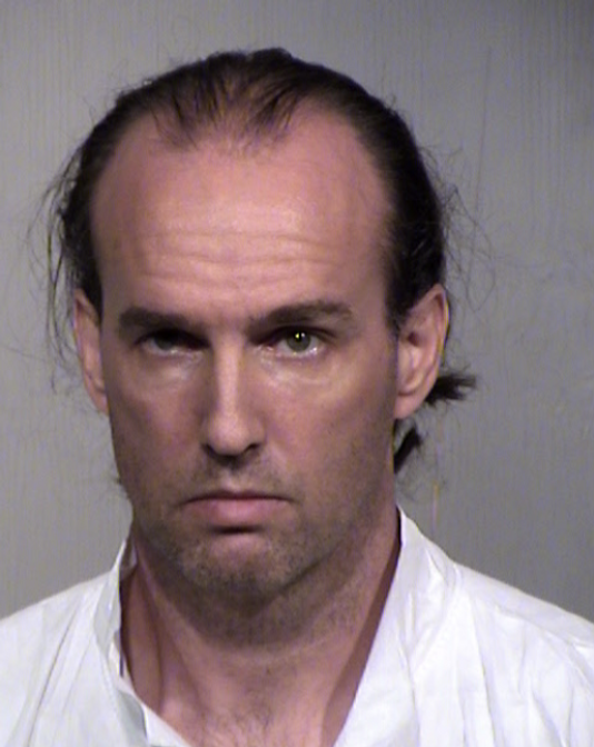 According to a probable cause statement, dispatch received a phone call from 45-year-old Jonathan Conaway (pictured) on Monday, reporting the death of his wife of 14 years, Janice. (Maricopa County Sheriff's Office)