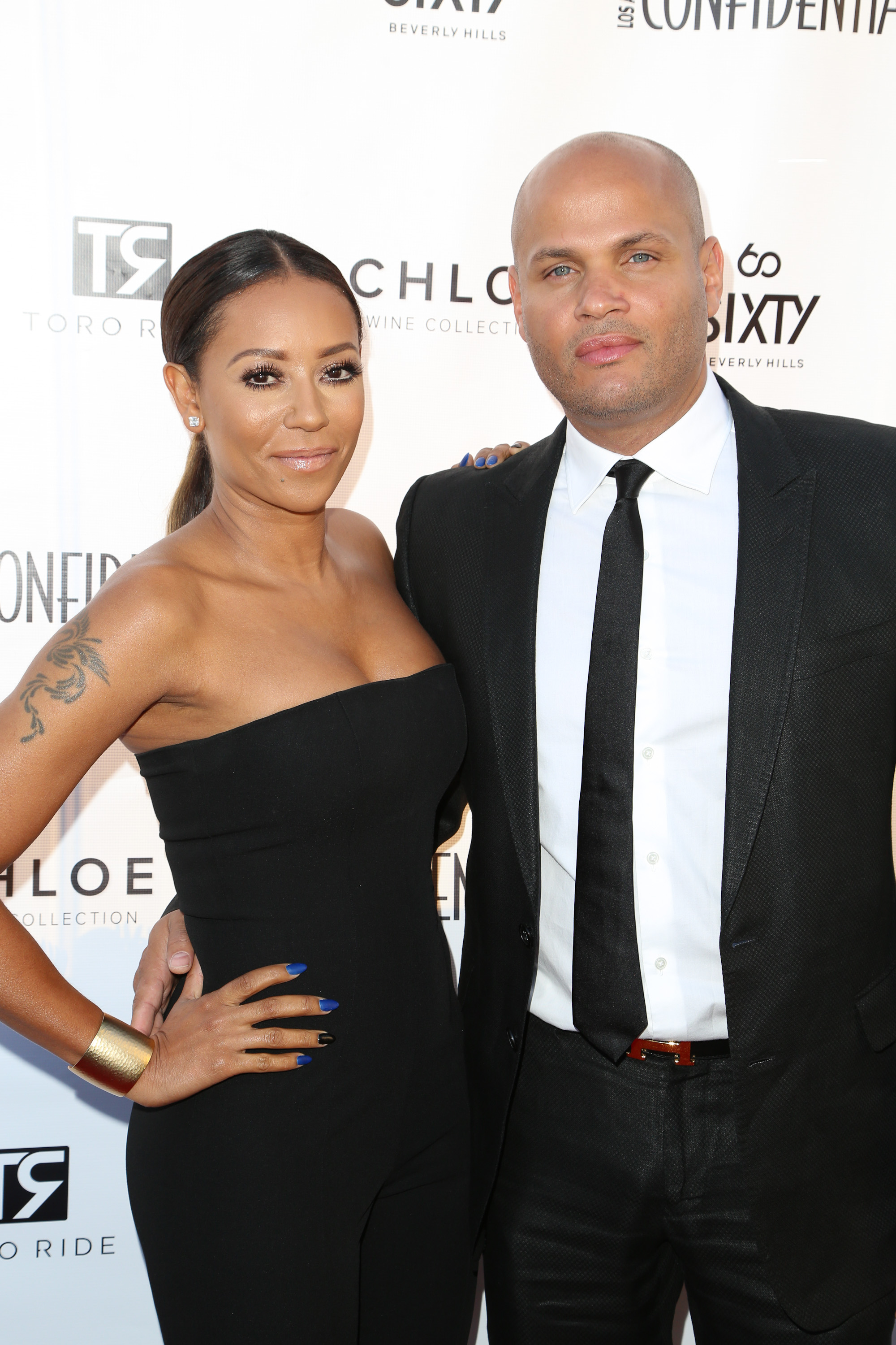 Singer Mel B. (L) and Stephen Belafonte attend the Los Angeles Confidential celebration of the Women of Influence issue with Robin Wright on June 4, 2014 in Beverly Hills, California.