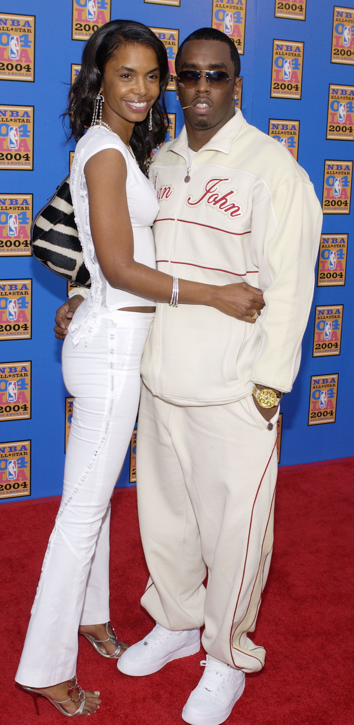 Recording artist and producer Sean 'P Diddy' Combs with his girlfriend Kim Porter attend the 2004 NBA All-Star Game held on February 15, 2004 at the Staples Center, in Los Angeles, California.