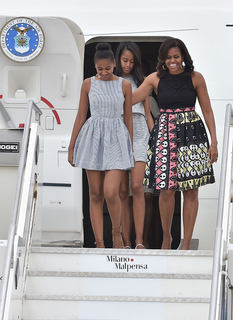 First Lady Michelle Obama arrives with daughters Malia Obama (C) and Sasha Obama (L) at Malpensa Airport on June 17, 2015 in Milan, Italy. (Photo by Jacopo Raule/Getty Images)