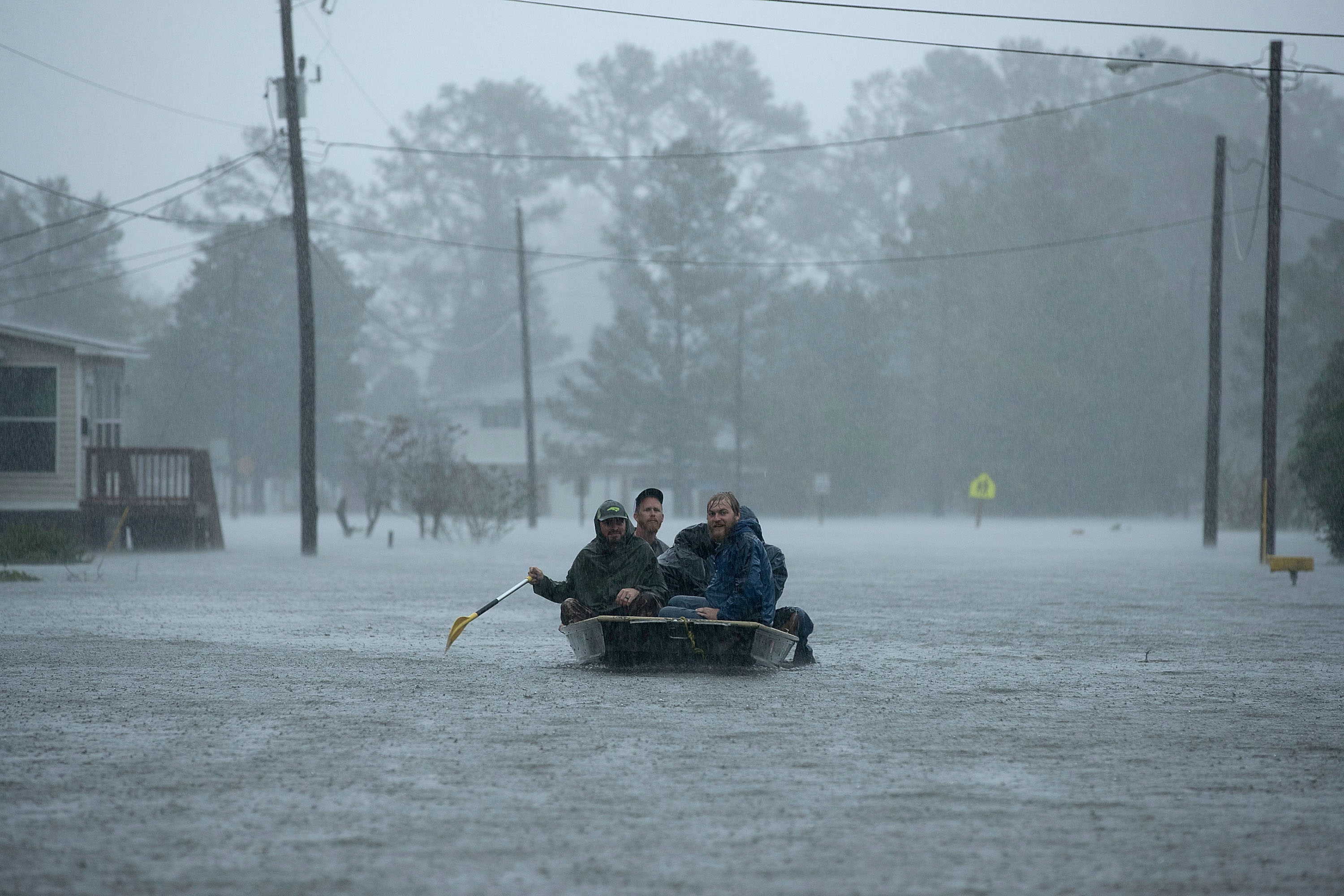 Volunteers from all over North Carolina help rescue residents from their flooded homes during Hurricane Florence September 14, 2018 in New Bern, North Carolina. Hurricane Florence made landfall in North Carolina as a Category 1 storm and flooding from the heavy rain is forcing hundreds of people to call for emergency rescues in the area around New Bern, North Carolina, which sits at the confluence of the Nuese and Trent rivers. The storm has since been downgraded to a tropical storm.