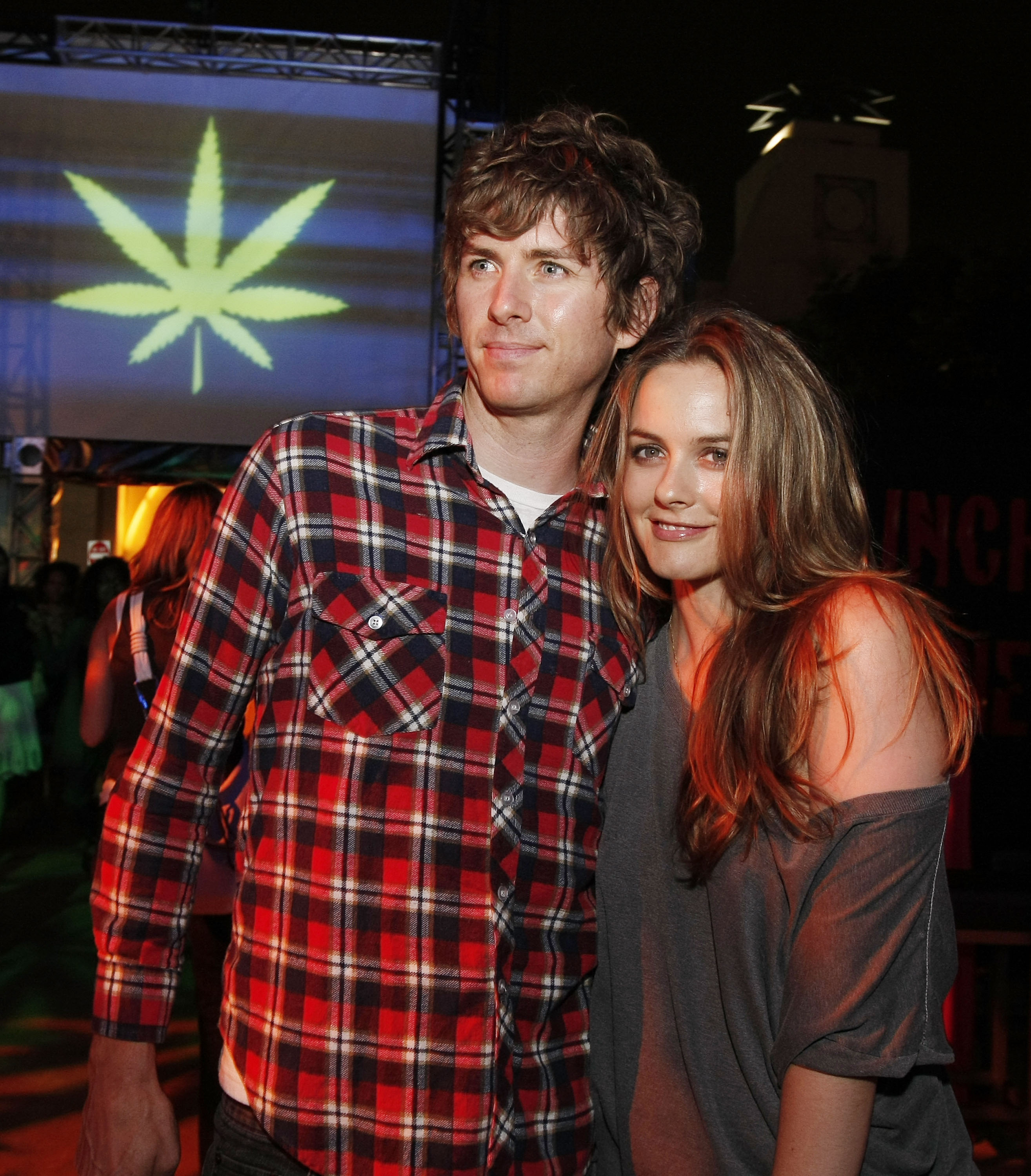 Actress Alicia Silverstone (R) and husband Christopher Jarecki pose at the afterparty for the premiere of Columbia Picture's 'Pineapple Express' at the Mann Village Theater on July 31, 2008, in Los Angeles, California (Getty Images)