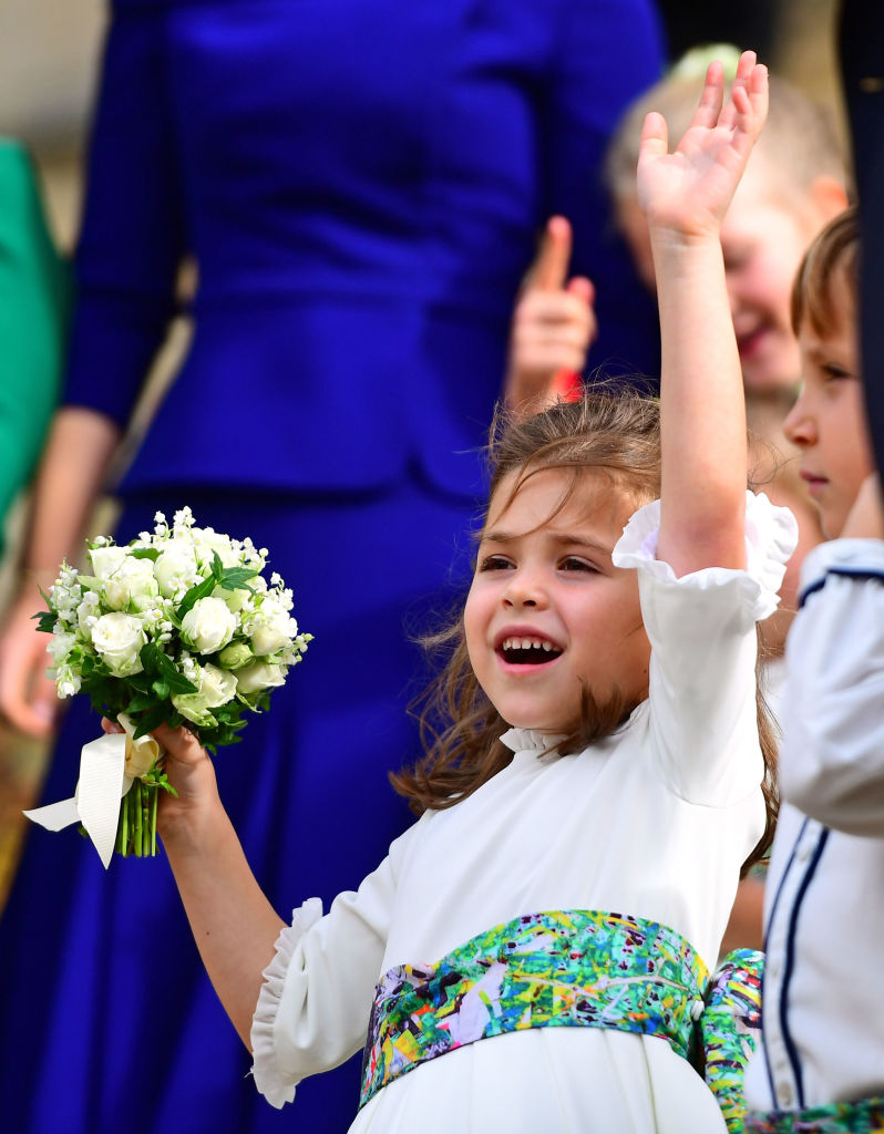 Bridesmaid Theodora Williams waves from the steps after the wedding of Princess Eugenie of York and Jack Brooksbank at St. George's Chapel on October 12, 2018 in Windsor, England. (Photo by - WPA Pool/Getty Images)