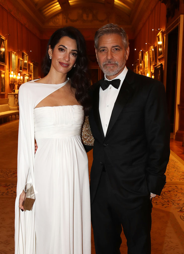Amal Clooney and George Clooney attend a dinner to celebrate The Prince's Trust, hosted by Prince Charles, Prince of Wales at Buckingham Palace on March 12, 2019, in London, England. (Photo by Chris Jackson - WPA Pool/Getty Images)