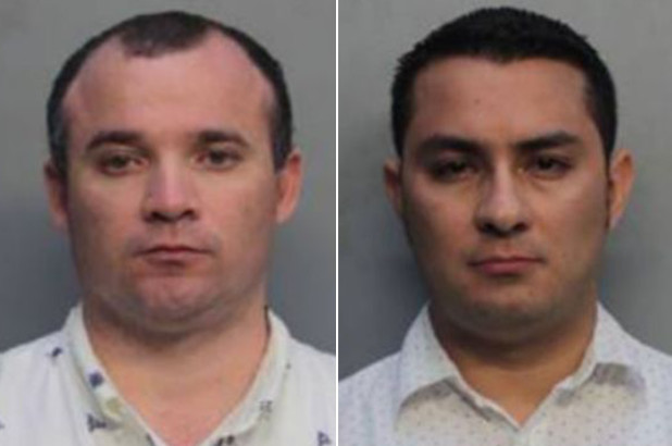 Diego Berrio and Edwin Giraldo Cortez were taken into custody after they were allegedly caught performing sex acts in a parked rental car near Miami Beach, reports said (Miami Beach Police Department)