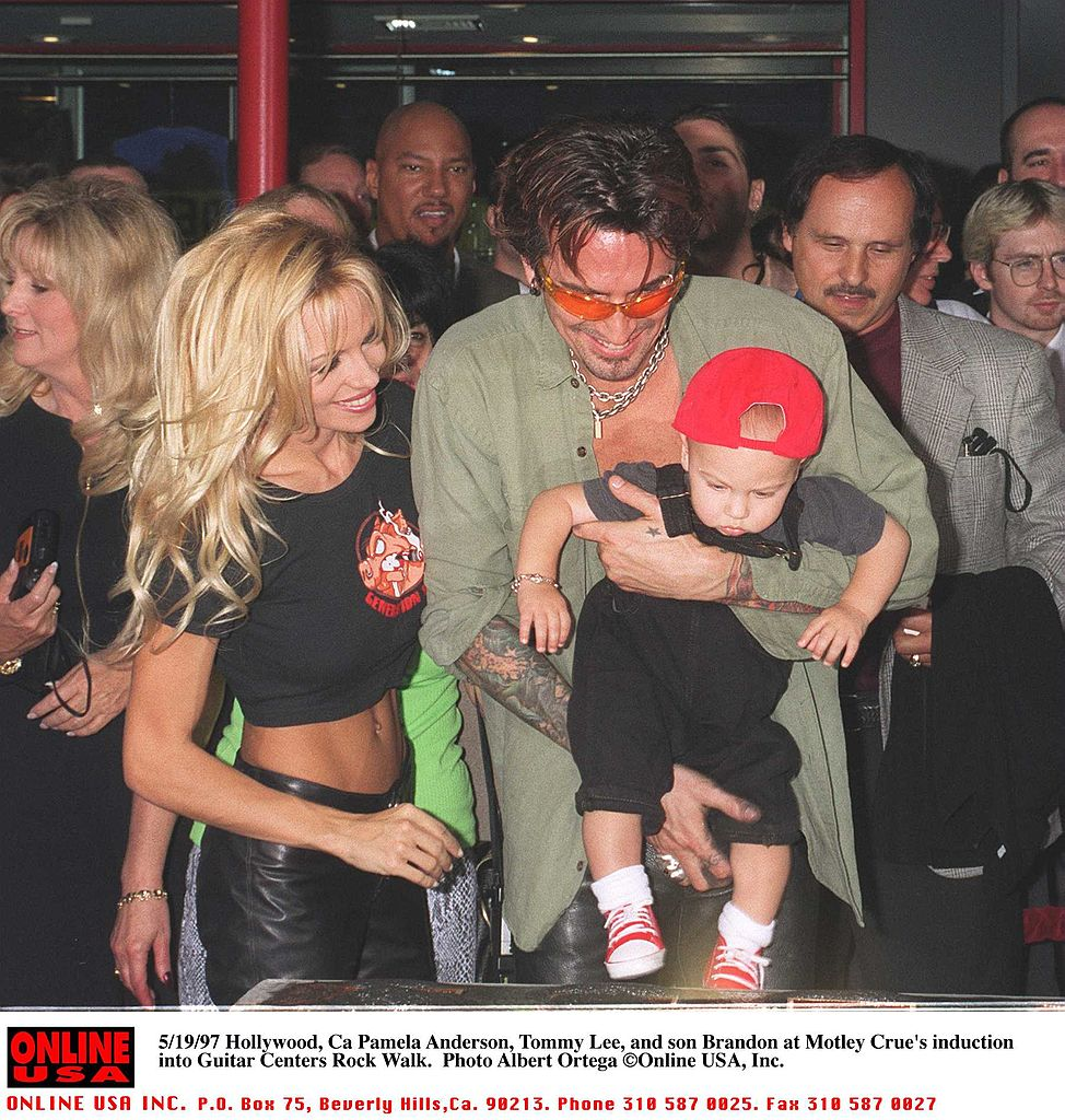 Pamela Anderson Lee, Tommy Lee, and son Brandon at Motley Crue's Walk of Fame induction on Sunset Blvd. on May 20, 1997 (Source: Getty Images)