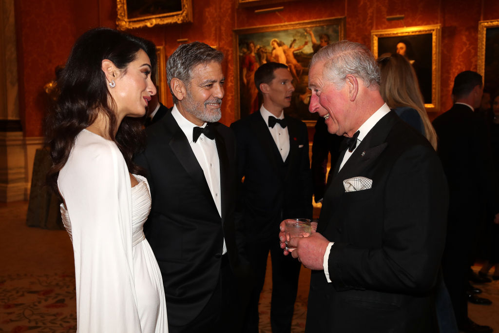 The A-list couple, who have had a close relationship with the British royals, were spotted having an intensely animated conversation with the Prince of Wales. (Photo by Chris Jackson - WPA Pool/Getty Images)