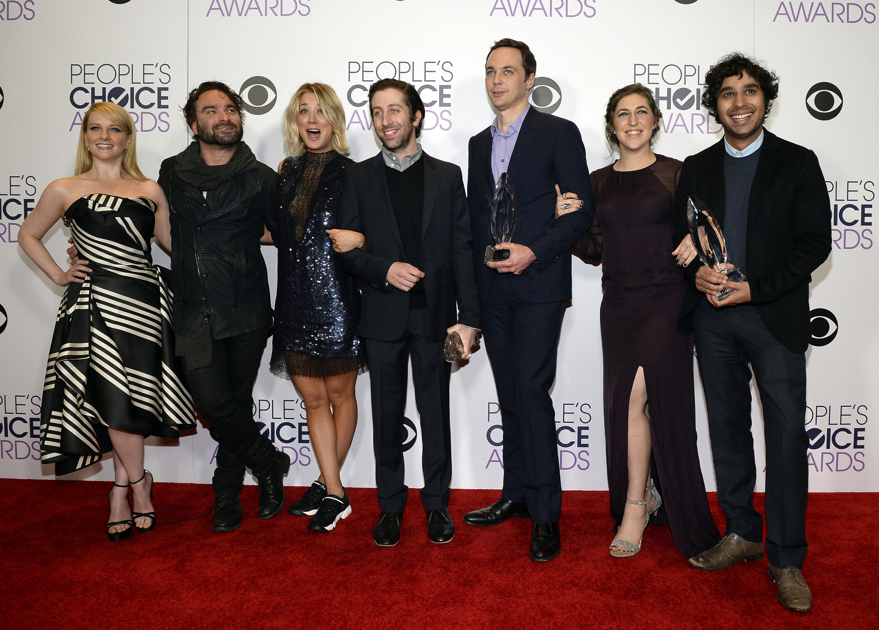 Actors Melissa Rauch, Johnny Galecki, Kaley Cuoco, Simon Helberg, Jim Parsons, Mayim Bialik and Kunal Nayyar, winners of Favorite Network TV Comedy and Favorite TV Show for 'The Big Bang Theory', pose in the press room during the People's Choice Awards 2016 at Microsoft Theater on January 6, 2016 in Los Angeles, California. (Photo by Kevork Djansezian/Getty Images)