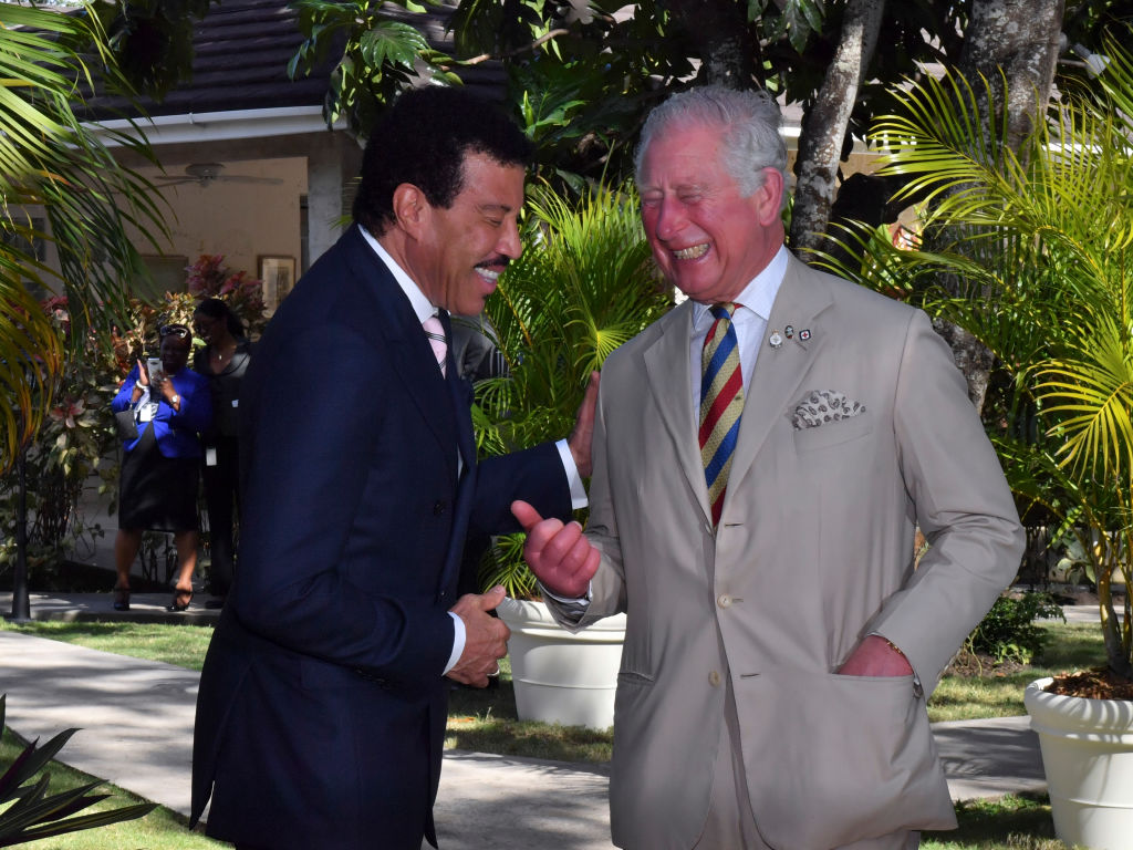 Lionel Richie and Prince Charles, Prince of Wales attend a Prince's Trust International Reception at the Coral Reef Club Hotel on March 19, 2019 in Folkestone, Barbados. (Photo by Arthur Edwards - Pool/Getty Images)