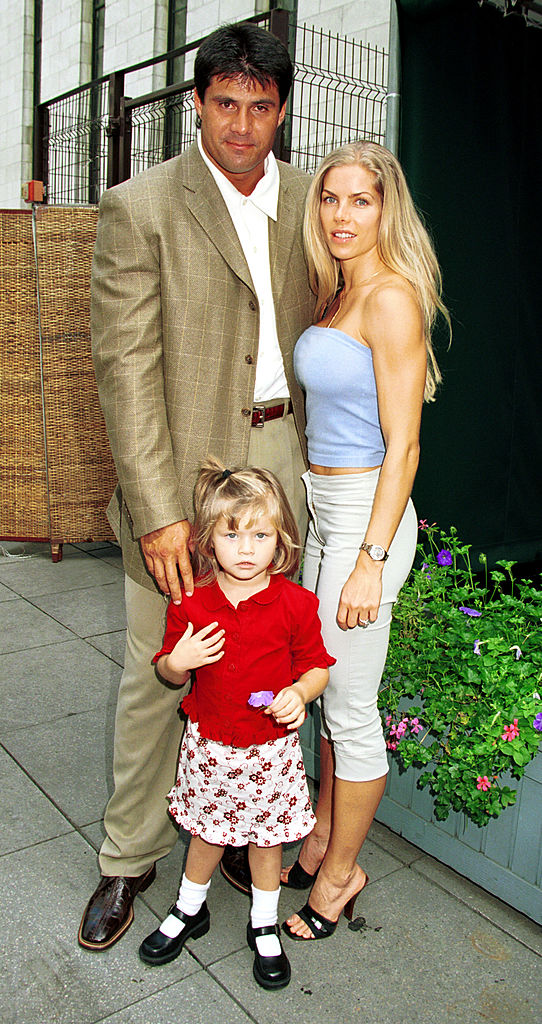 N.Y. Yankee's D. H. hitter Jose Canseco with his wife Jessica and daughter Josie attend September 14, 2000 the Joseph Abboud Spring 2001 fashion show at Bryant Park, in New York City. (Photo by George De Sota/Liason)