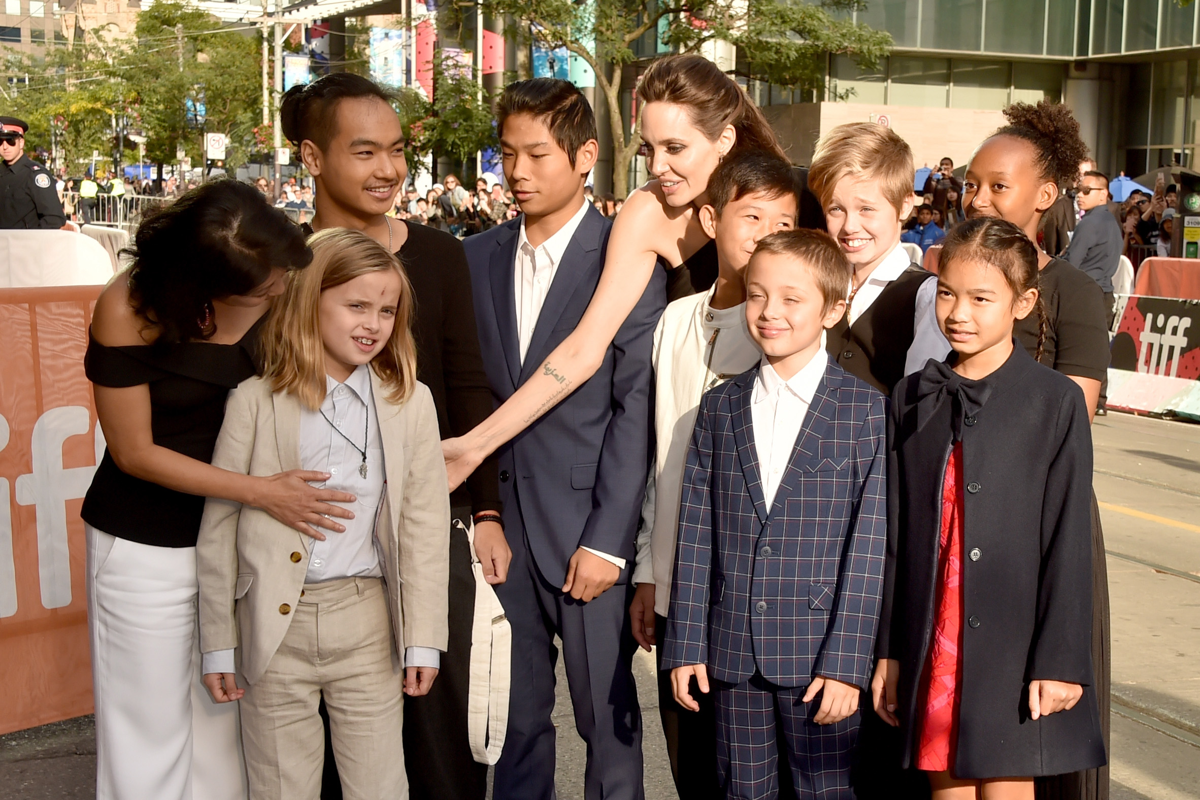 (L-R) Loung Ung, Vivienne Jolie-Pitt, Maddox Jolie-Pitt, Pax Jolie-Pitt, Angelina Jolie, Kimhak Mun, Knox Jolie-Pitt, Shiloh Jolie-Pitt, Zahara Jolie-Pitt and Sareum Srey Moch attend the 'First They Killed My Father' premiere during the 2017 Toronto International Film Festival at Princess of Wales Theatre on September 11, 2017 in Toronto, Canada. Source: Getty