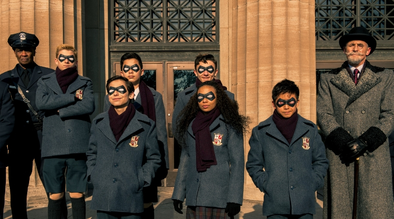 'The Umbrella Academy' with a bloody Ben Hargreeves (second to last) after the foiled a bank robbery in 'The Umbrella Academy'. (Source: Netflix)