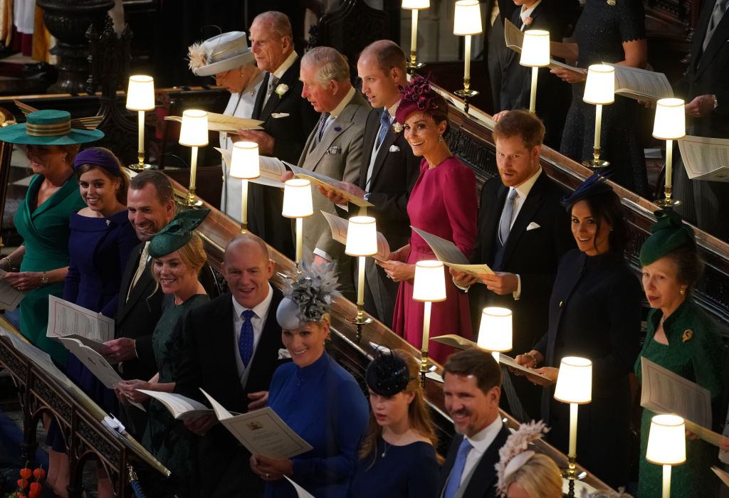 Back (L-R) Queen Elizabeth II, Prince Philip, Duke of Edinburgh, Prince Charles, Prince of Wales, Prince William, Duke of Cambridge, Catherine, Duchess of Cambridge, Prince Harry, Duke of Sussex, Meghan, Duchess of Sussex and Princess Anne, Princess Royal and (front L-R) Sarah Ferguson Princess Beatrice of York, Peter Phillips, Autumn Phillips, Mike Tindall, Zara Tindall Lady Louise Windsor and Crown Prince Pavlos of Greece attend the wedding of Princess Eugenie of York and Mr. Jack Brooksbank at St. George's Chapel on October 12, 2018, in Windsor, England. (Getty Images)