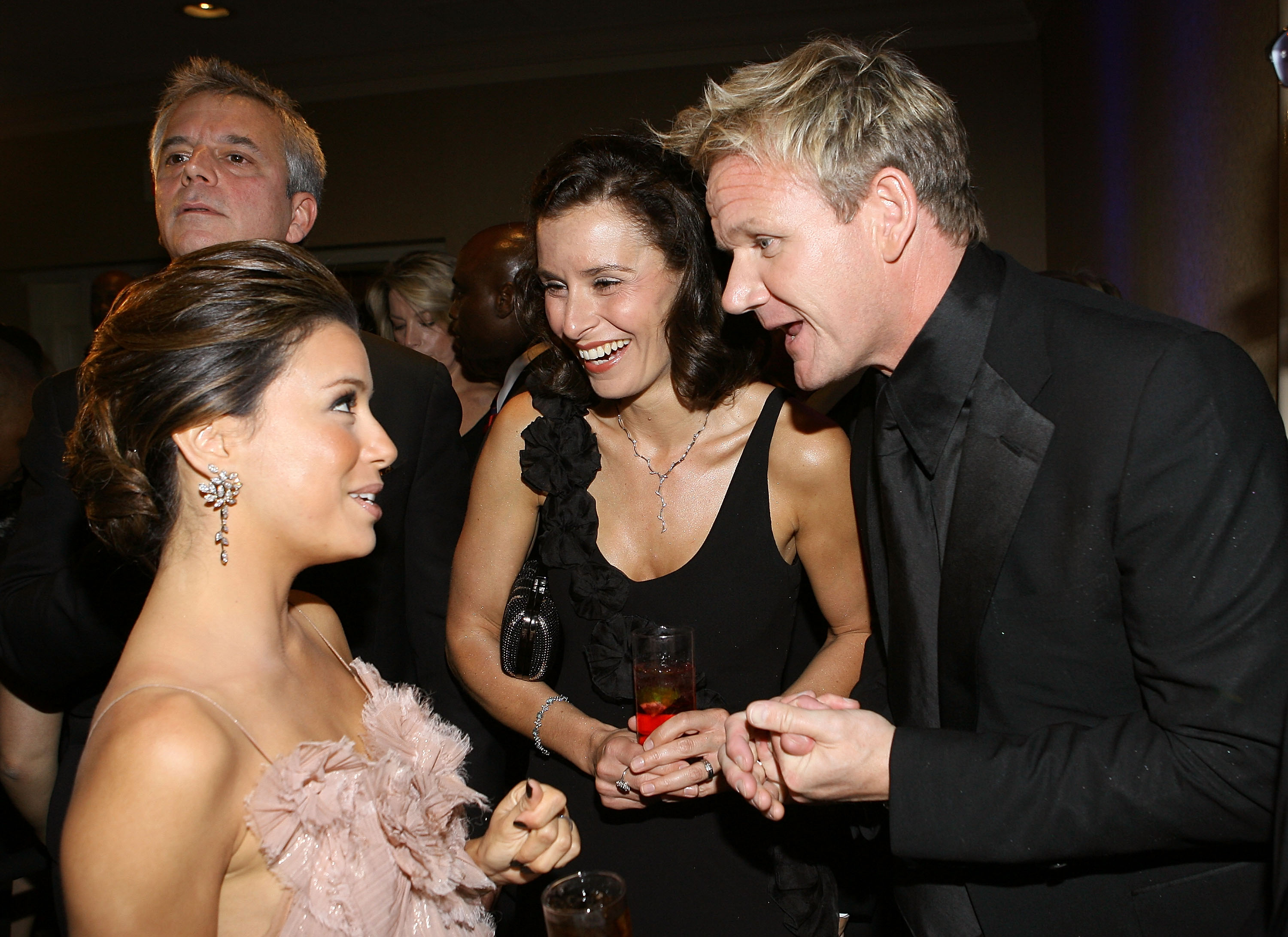 Gordon Ramsay (R) with wife Tana Ramsay and Eva Longoria Parker (L) attend the PEOPLE-TIME-FORTUNE-CNN White House Correspondents dinner cocktail party at Hilton Hotel on May 9, 2009 in Washington, DC. (Photo by Michael Tran/Getty Images for Time)