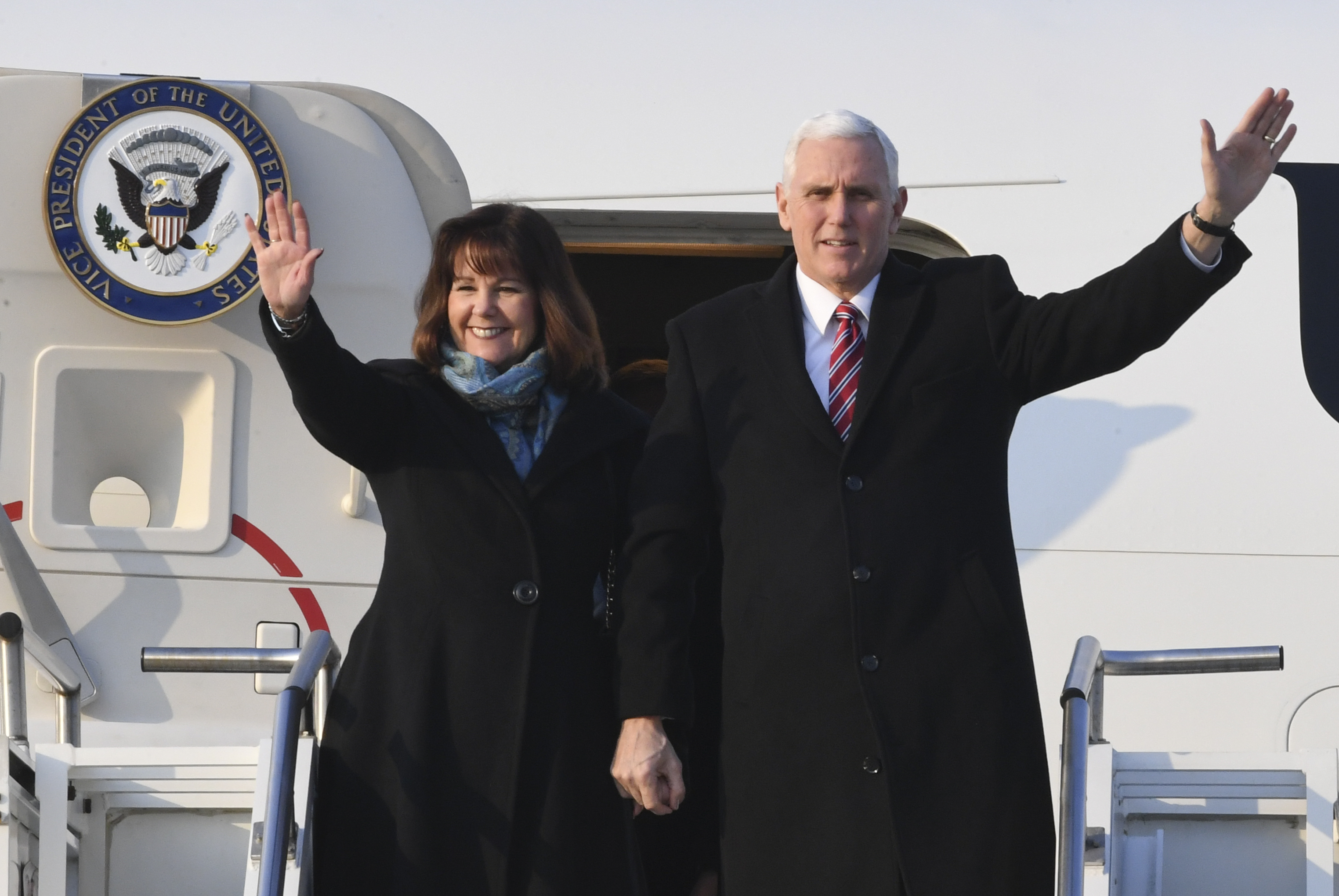 U.S. Vice President Mike Pence (R) and his wife Karen Pence wave upon arriving at the Osan Air Base on February 8, 2018, in Pyeongtaek, South Korea. (Getty)
