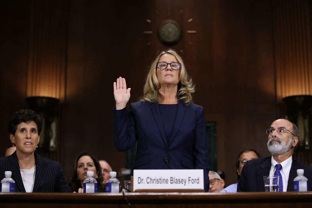 Christine Blasey Ford is sworn in before testifying the Senate Judiciary Committee in the Dirksen Senate Office Building on Capitol Hill September 27, 2018, in Washington, DC (Source: Win McNamee/Getty Images)