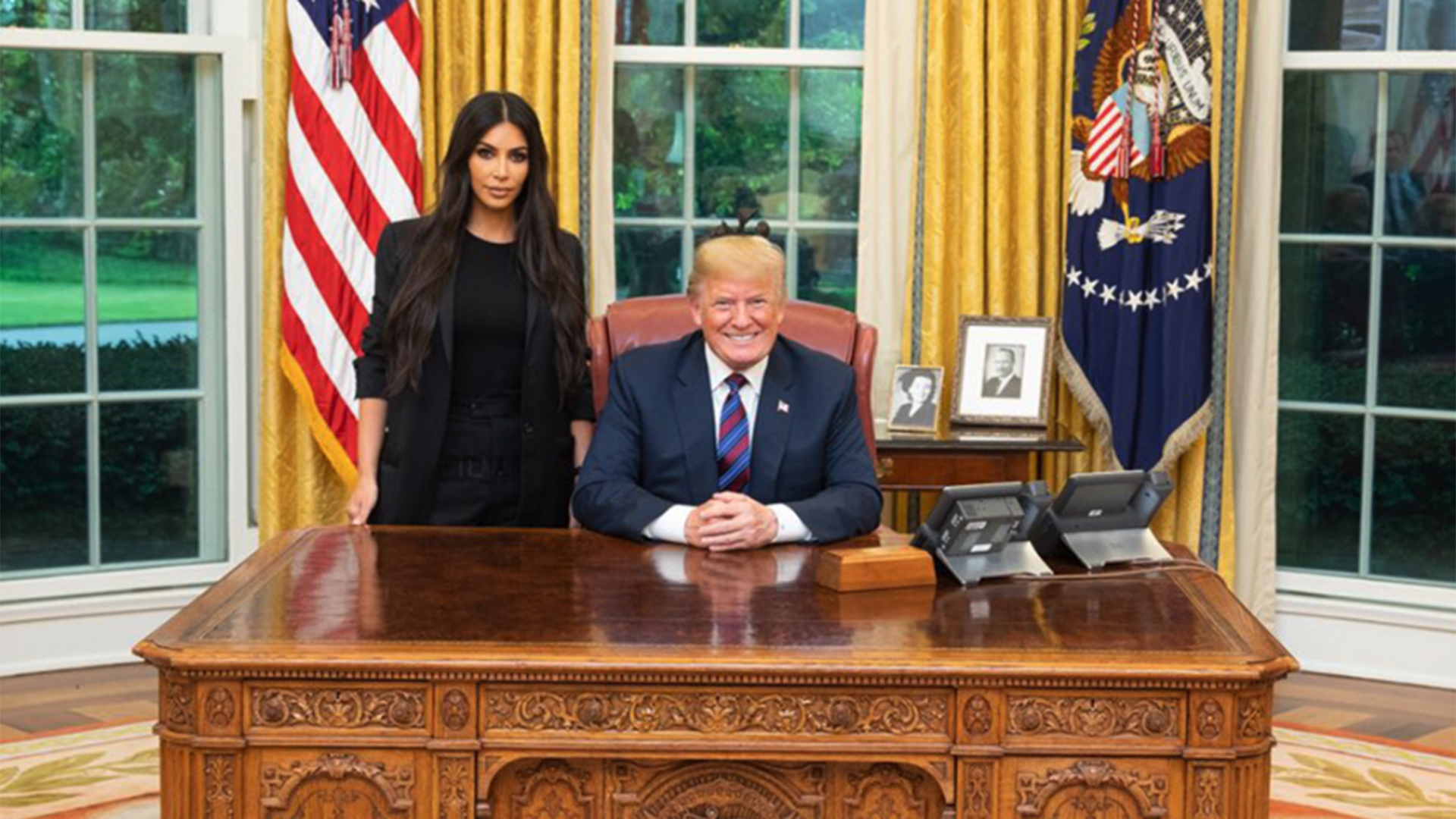 The image shows Kim Kardashian West's first lobbying meeting with Presiden Trump.