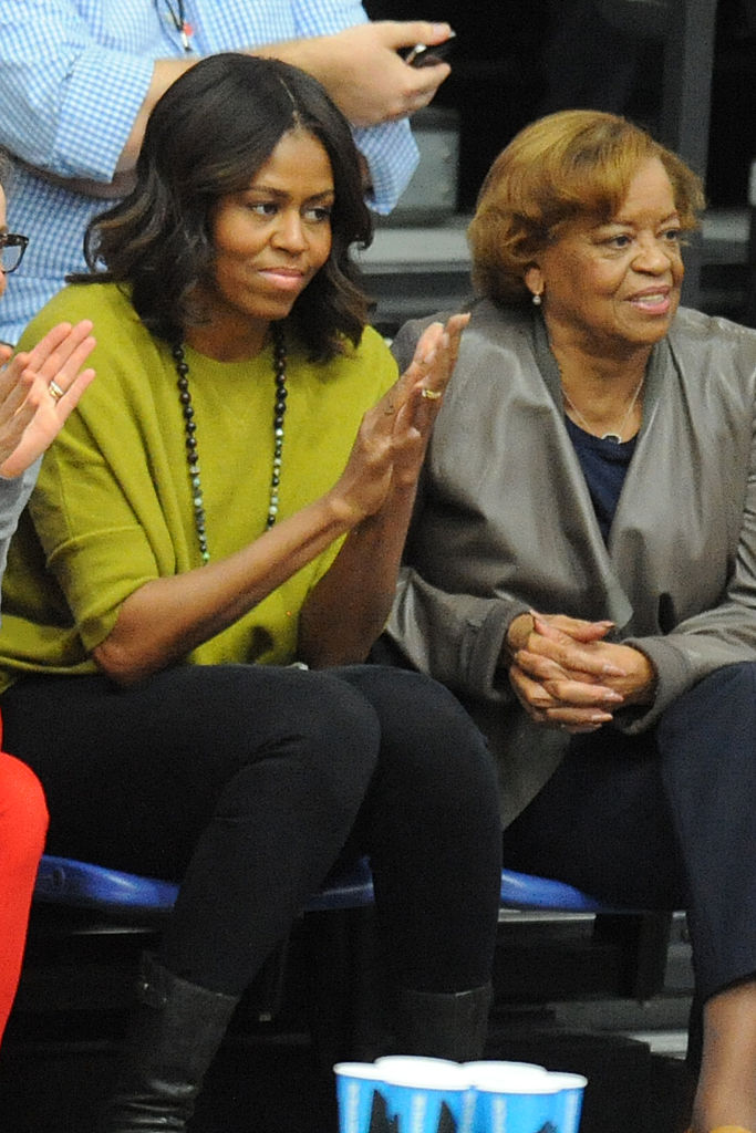 First Lady Michelle Obama (L) and Marian Robinson (R) watch a women's college basketball game between the Princeton Tigers and the American University Eagles at Bender Arena on November 23, 2014. in Washington, DC. (Getty Images)