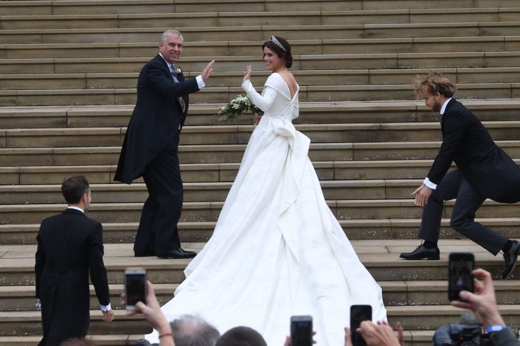 Princess Eugenie of York and her father, Prince Andrew, the Duke of York, arrive at St George's Chapel for her wedding to Jack Brooksbank in Windsor Castle on October 12, 2018, in Windsor, England. (Getty Images)