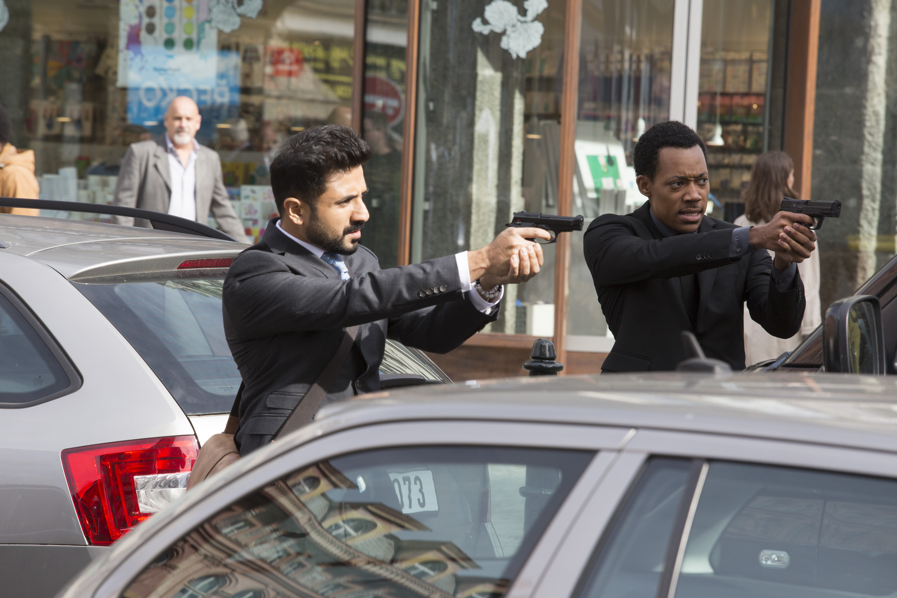 Jai Datta (Vir Das) and Edgar Standish (Tyler James Williams) in 'Whiskey Cavalier' (Source: ABC)