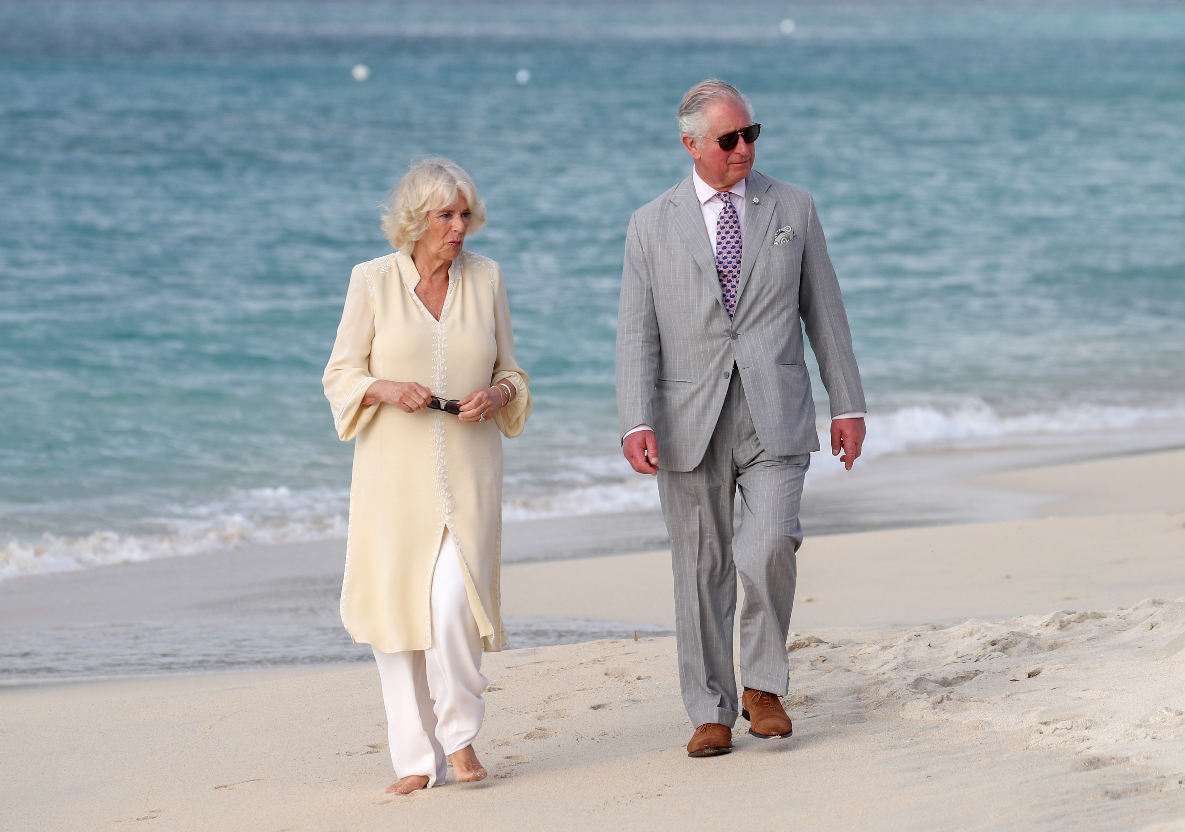 Prince Charles, Prince of Wales and Camilla, Duchess of Cornwall attend an engagement on the beach during their official visit to Grenada on March 23, 2019 in Saint George's, Grenada. (Photo by Chris Jackson/Getty Images,)