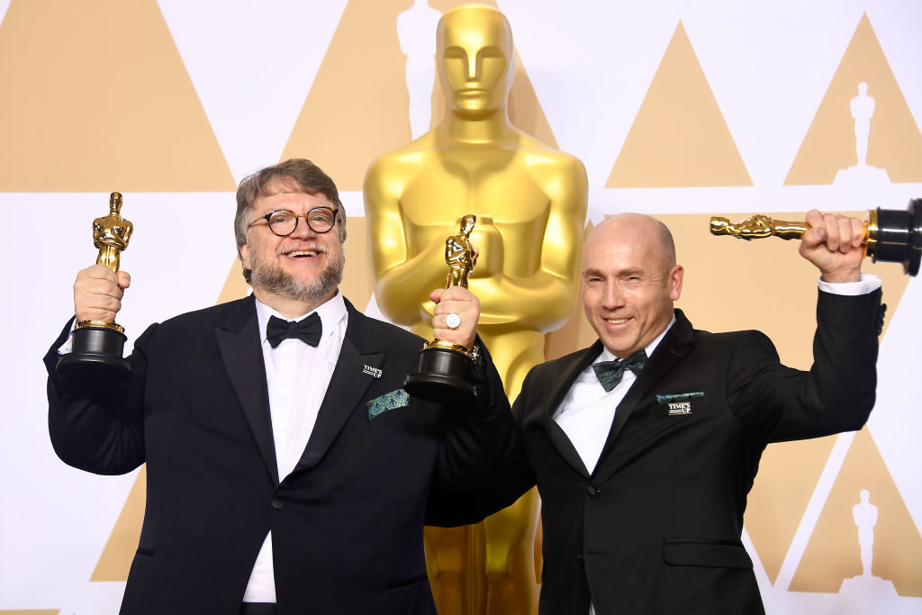 Filmmaker Guillermo del Toro (L), winner of the Best Director and Best Picture awards for 'The Shape of Water,' and producer J. Miles Dale, winner of the Best Picture award for 'The Shape of Water,' pose in the press room during the 90th Annual Academy Awards at Hollywood & Highland Center on March 4, 2018 in Hollywood, California. (Photo by Frazer Harrison/Getty Images)