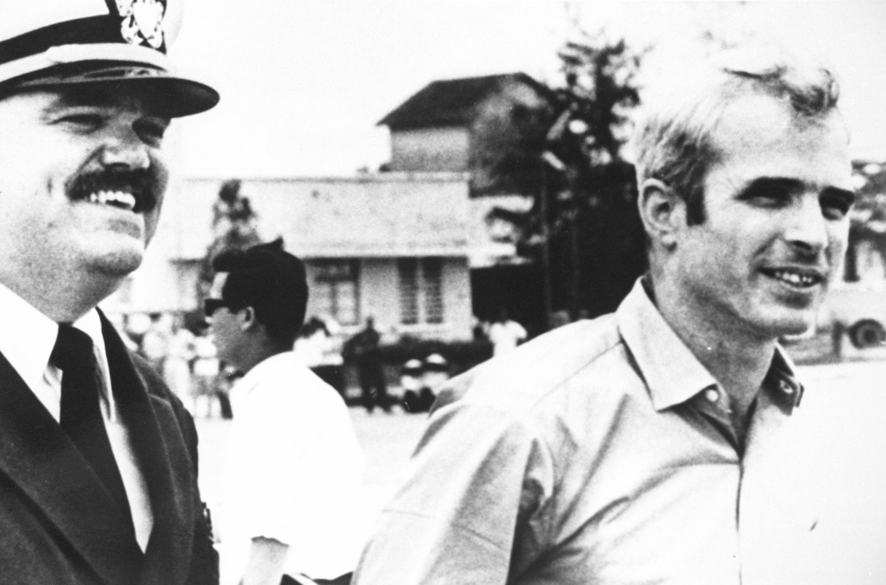 (File Photo) U.S. Navy Lt. Cmdr. Jay Coupe, Left, Escorts Lt. Cmdr. John Mccain To A Waiting U.S. Air Force C-141A Starlifter Cargo Transport Aircraft At Gia Lam Airport March 14, 1973 In Hanoi, North Vietnam. Senator Mccain Had Just Been Released From A North Vietnamese Prison Camp.
