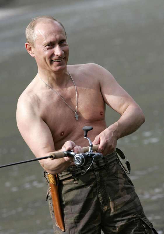 The Russian strongman is seen shirtless once again while sporting a fishing rod. (Getty)