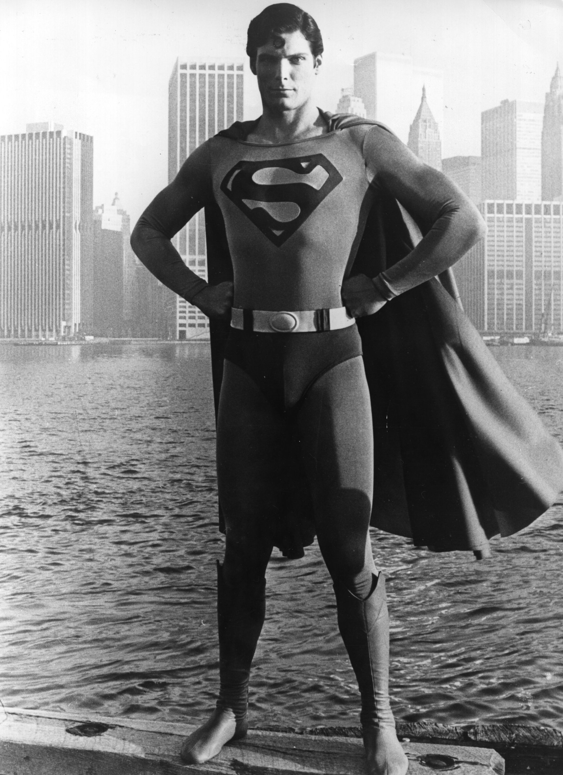24-year-old American film actor Christopher Reeve stands before the Manhattan skyline dressed as the comic-book hero of the film 'Superman'. (Photo by Keystone/Getty Images)