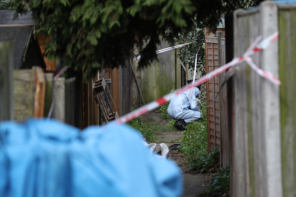 Police forensics officers in an alleyway at the back of properties on Darell Road in Kew, South-West London where the body of Laureline Garcia-Bertaux, 34, from Richmond, was found in a shallow grave in the garden. Police have launched a murder investigation. (Photo by Steve Parsons/PA Images via Getty Images)
