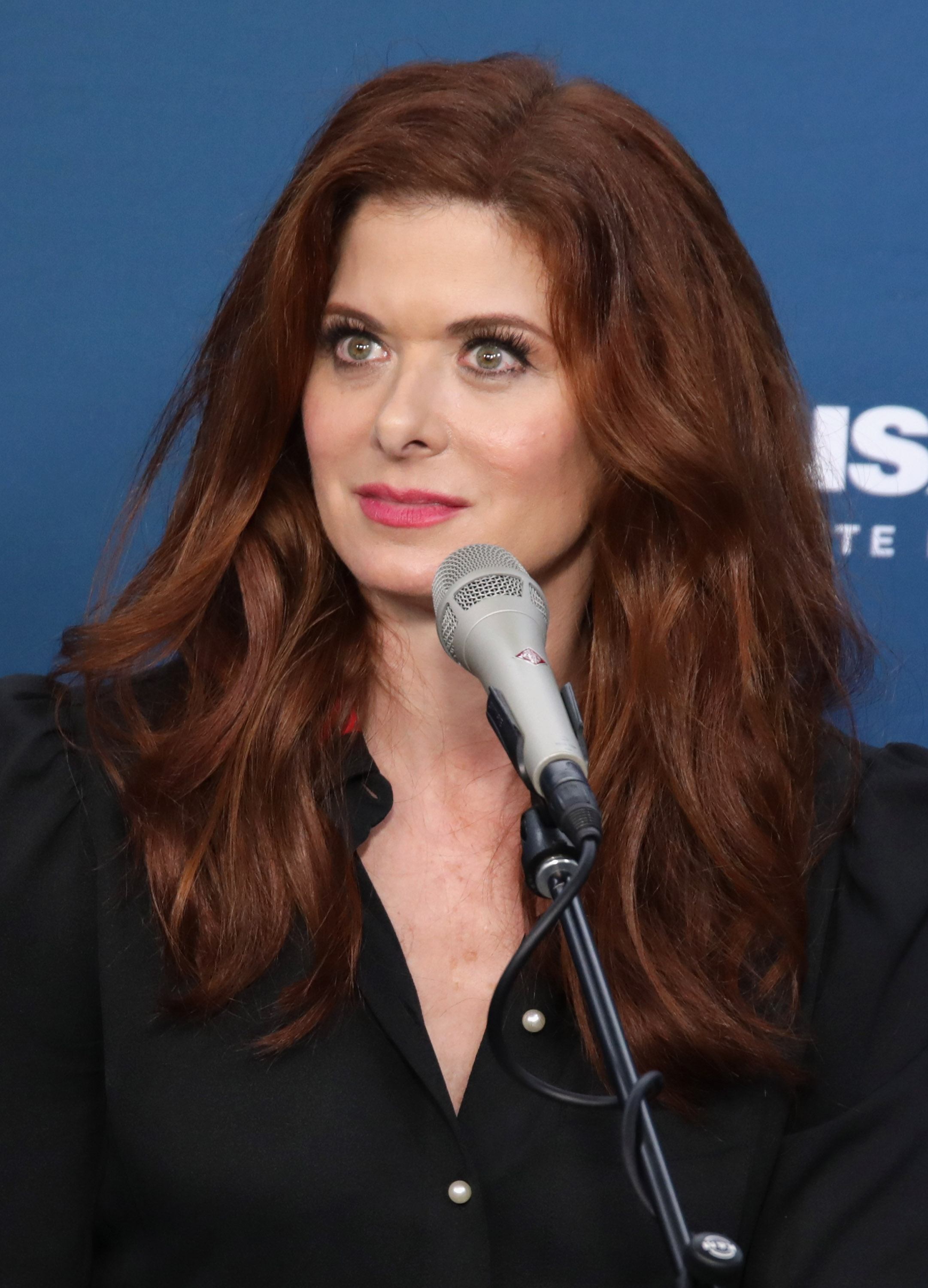 Actress Debra Messing takes part in SiriusXM's 'Town Hall' with the cast of 'Will & Grace' hosted by Andy Cohen (C) on September 25, 2017 in New York City.