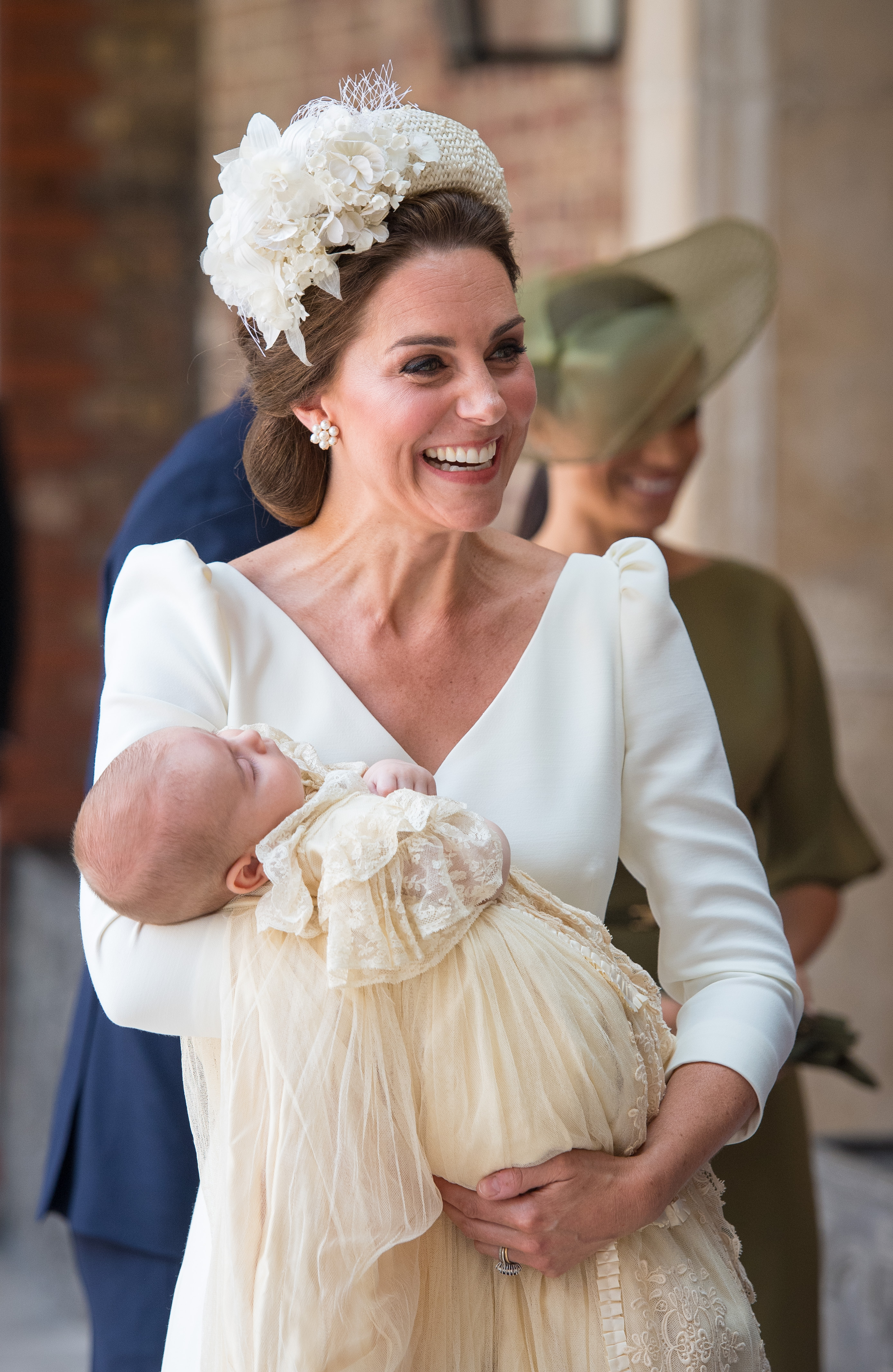 Catherine, Duchess of Cambridge, carries Prince Louis as they arrive for his christening service at St James's Palace on July 09, 2018 in London, England. (Getty Images)