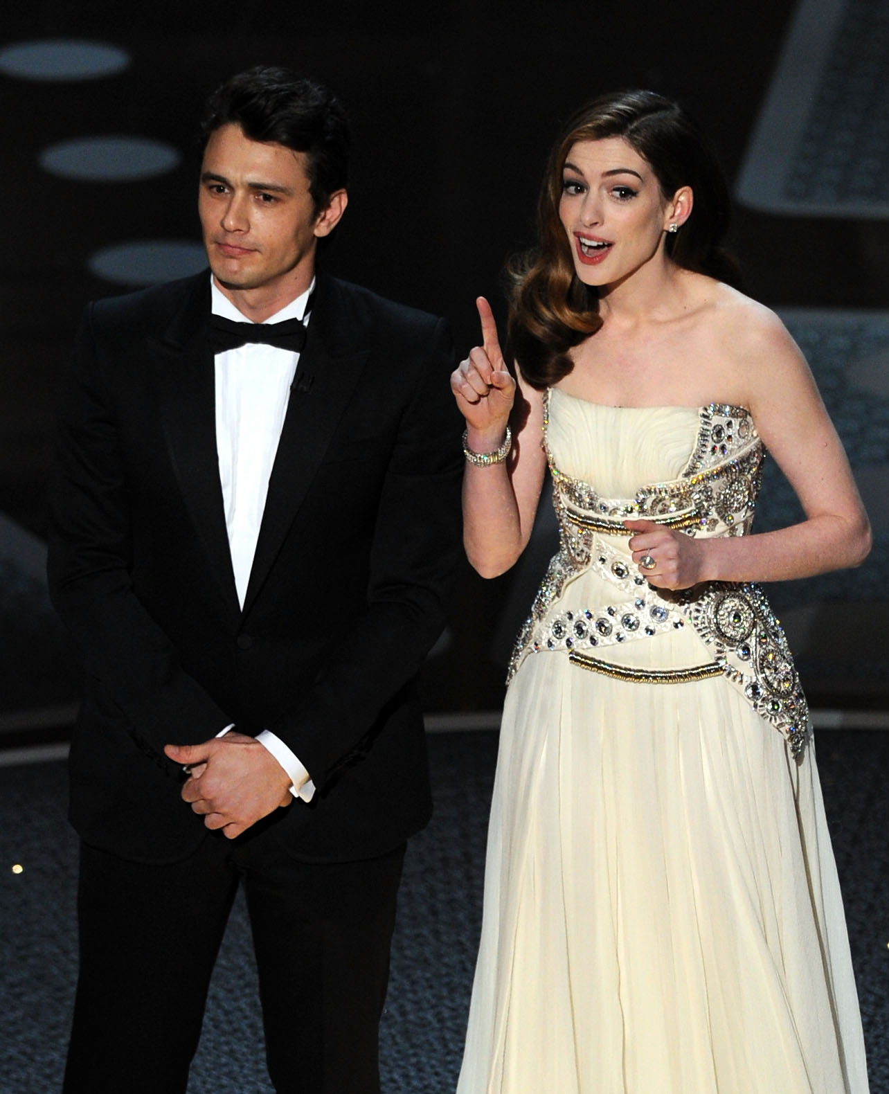 Hosts James Franco and Anne Hathaway speak onstage during the 83rd Annual Academy Awards held at the Kodak Theatre on February 27, 2011 in Hollywood, California.