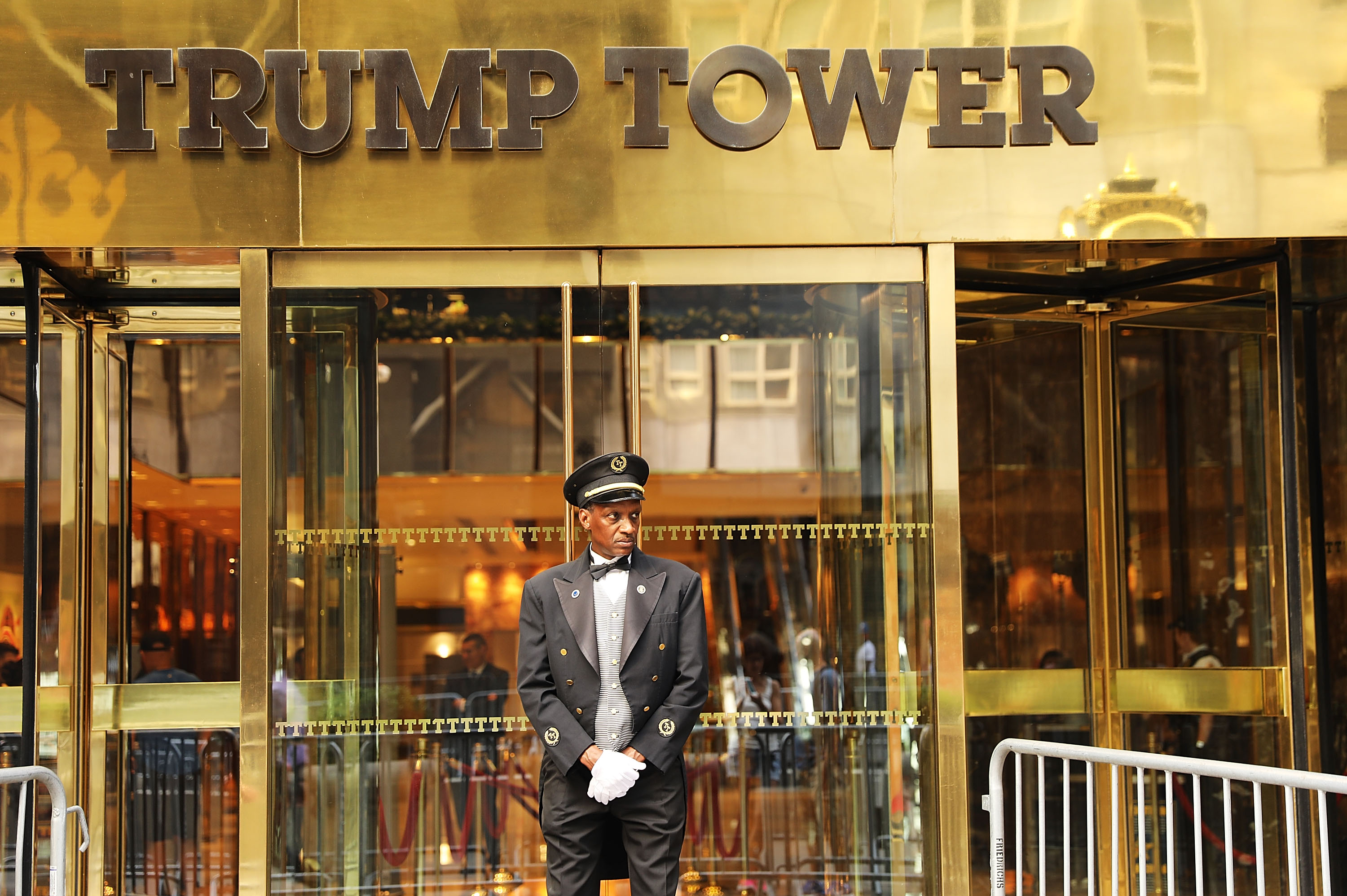 A doorman stands in front of Trump Tower along Fifth Avenue on August 14, 2017 in New York City. (Getty Images)