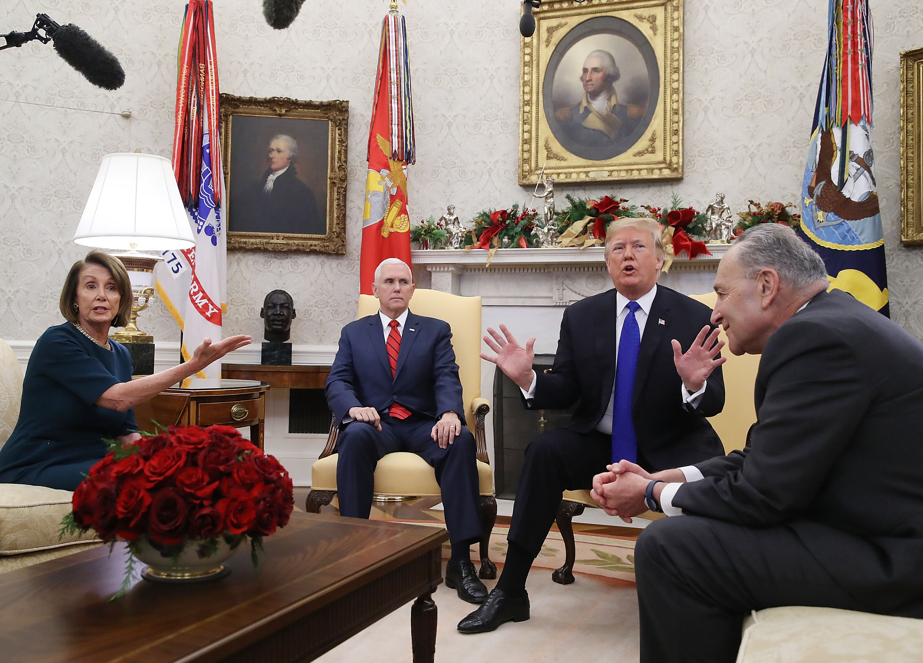 U.S. President Donald Trump (2R) argues about border security with Senate Minority Leader Chuck Schumer (D-NY) (R) and House Minority Leader Nancy Pelosi (D-CA) as Vice President Mike Pence sits nearby in the Oval Office on December 11, 2018 in Washington, DC. (Getty Images)