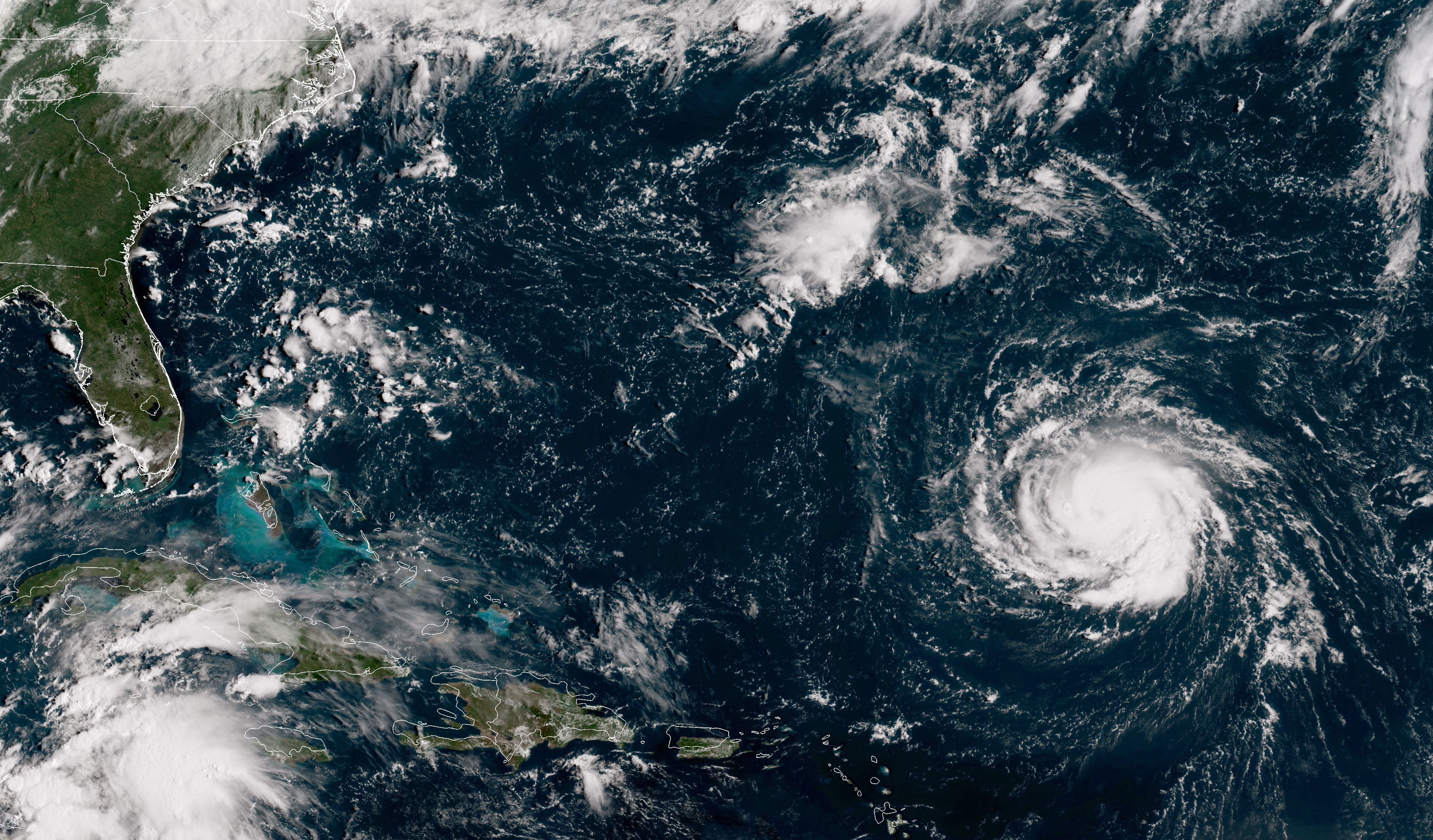 In this NOAA satellite handout image, shows Hurricane Florence as it travels west and gains strength in the Atlantic Ocean southeast of Bermuda on September 10, 2018. Weather predictions say the storm will likely hit the U.S. East Coast as early as Thursday, September 13 bringing massive winds and rain.