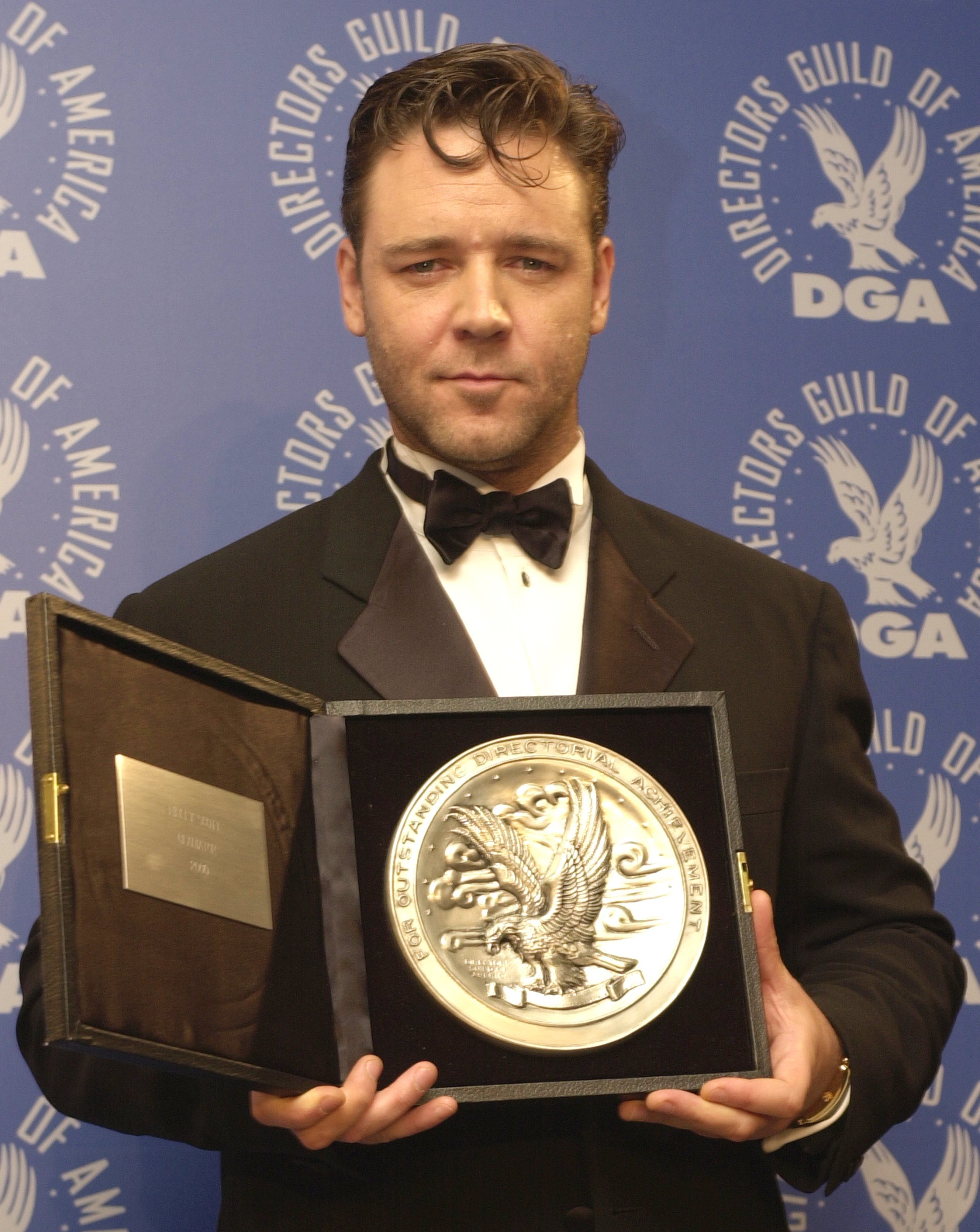 Actor Russell Crowe, accepting the nominee's plate for Outstanding Directorial Achievement in Feature Film on behalf of director Ridley Scott and his film 'Gladiator', poses for photographers at the 53rd Annual Directors Guild of America Awards March 10, 2001, at the Century Plaza Hotel in Century City, CA. (Getty Images)