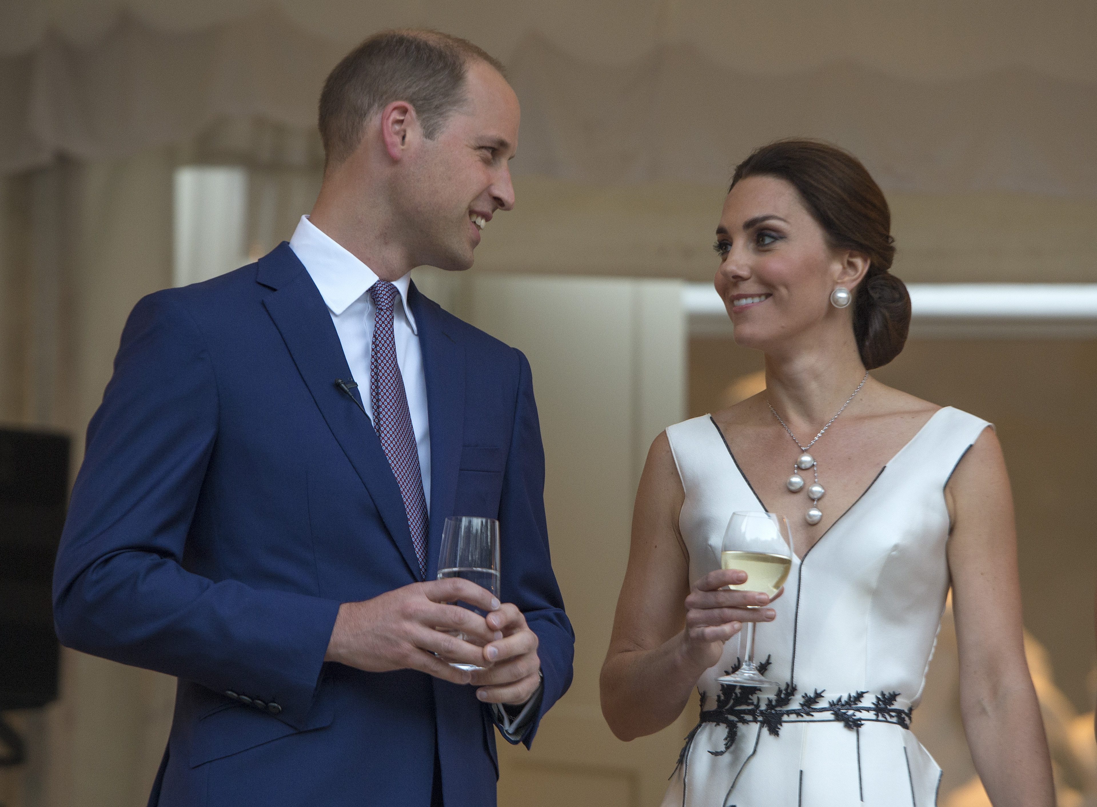 Prince William, Duke of Cambridge and Catherine, Duchess of Cambridge prepare to toast HM The Queen at the Queen's Birthday Garden Party at the Orangery, Lazienki Park on day 1 of their official visit to Poland on July 17, 2017 in Warsaw, Poland.