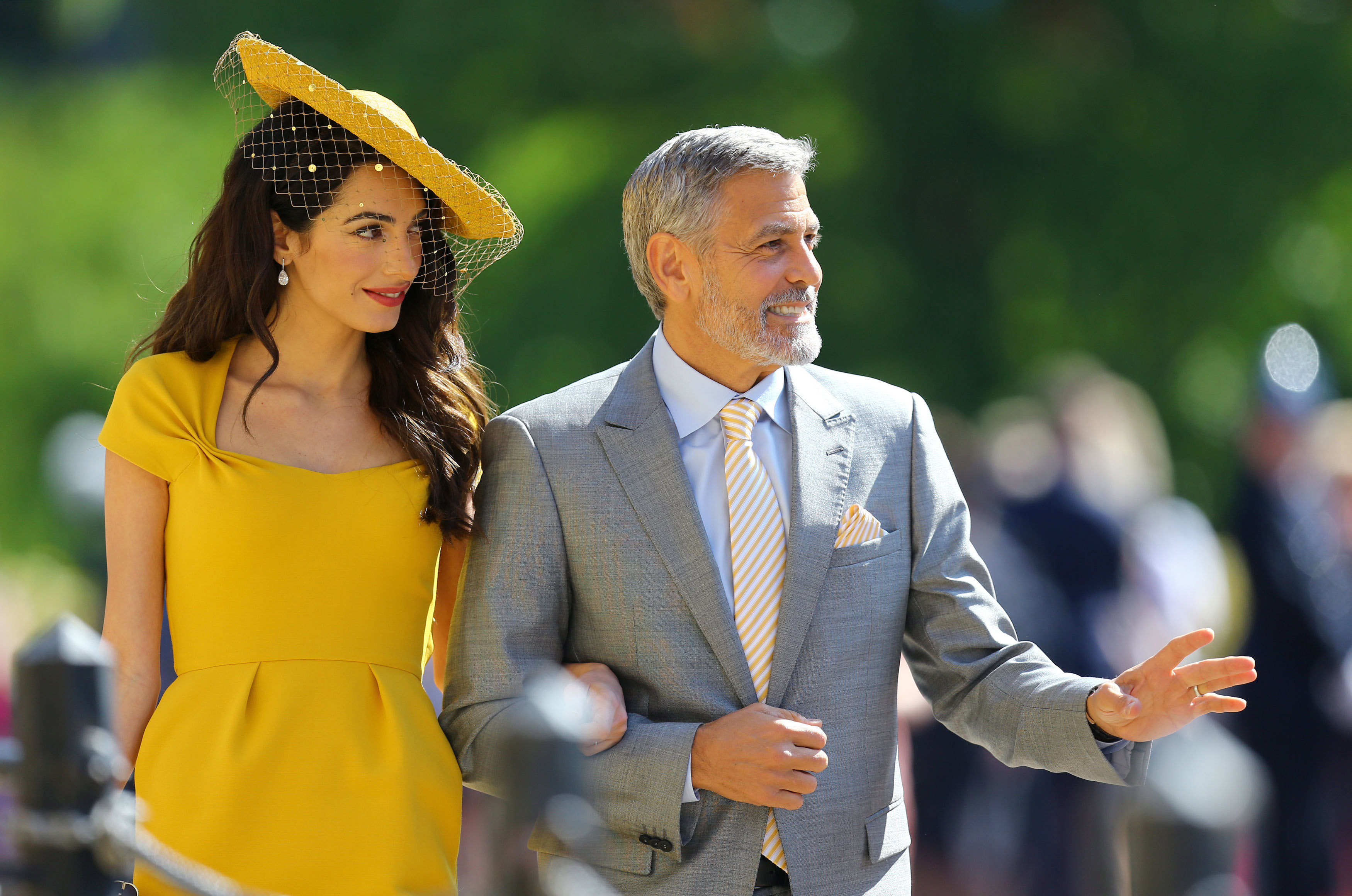 Amal Clooney and George Clooney arrive at St George's Chapel at Windsor Castle before the wedding of Prince Harry to Meghan Markle on May 19, 2018, in Windsor, England. (Getty)