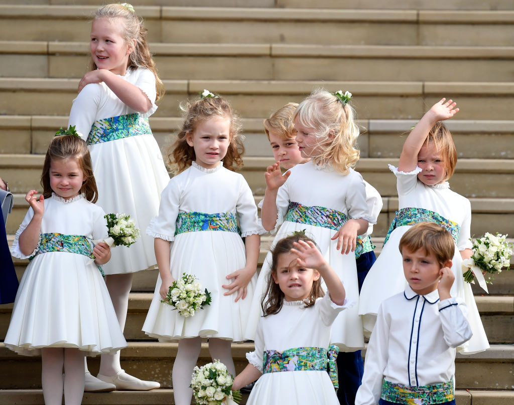 Bridesmaids Princess Charlotte of Cambridge, Savannah Phillips, Maud Windsor, page boy Prince George of Cambridge, bridesmaids Isla Phillips, Theodora Williams, Mia Tindall and page boy Louis de Givenchy wave as they leave after the royal wedding of Princess Eugenie of York to Jack Brooksbank at St. George's Chapel on October 12, 2018, in Windsor, England. (Getty Images)