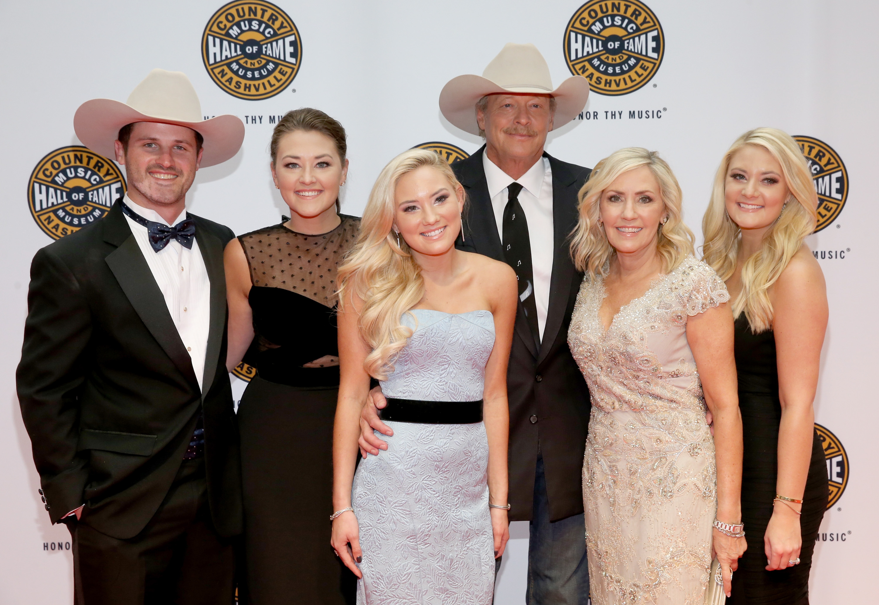Alan Jackson and family (L-R) Ben Selecman, Mattie Jackson, Dani Jackson, Denise Jackson, and Alexandra Jackson attend the Country Music Hall of Fame and Museum Medallion Ceremony to celebrate 2017 hall of fame inductees Alan Jackson, Jerry Reed And Don Schlitz at Country Music Hall of Fame and Museum on October 22, 2017 in Nashville, Tennessee.