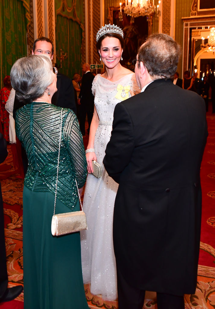 Catherine, Duchess of Cambridge greets guests at an evening reception for members of the Diplomatic Corps at Buckingham Palace on December 04, 2018 in London, England. (Photo by Victoria Jones - WPA Pool/Getty Images)