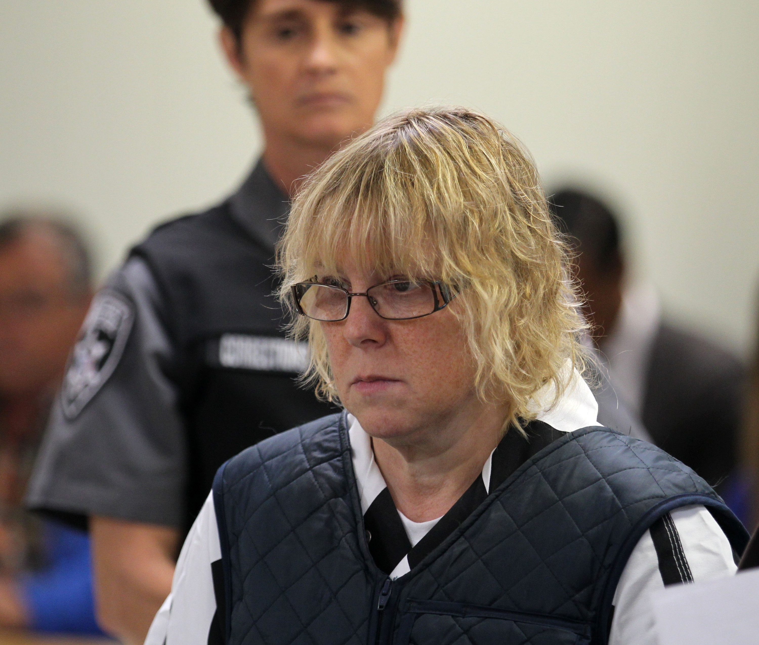 Joyce Mitchell (L) appears before Judge Buck Rogers in Plattsburgh City Court on June 15, 2015 in Plattsburgh, New York. Mitchell allegedly aided inmates Richard Matt and David Sweat in their escape from Clinton Correctional Facility.